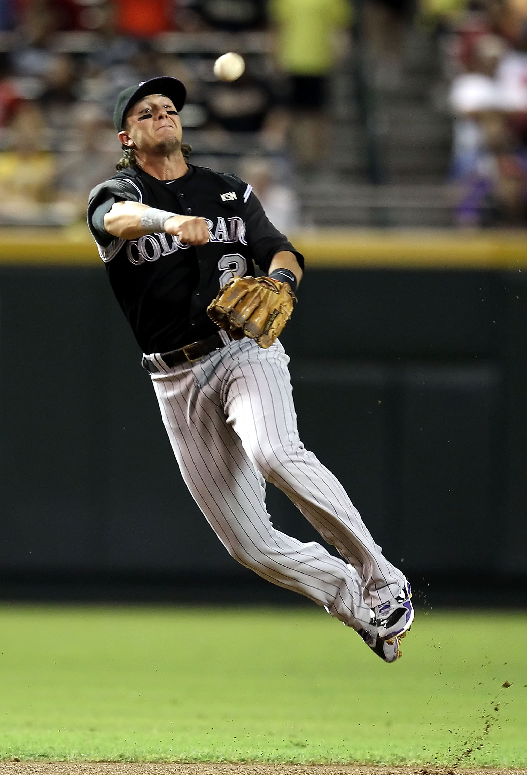 PHOENIX - SEPTEMBER 21:  Infielder Troy Tulowitzki #2 of the Colorado Rockies fields a ground ball out against the Arizona Diamondbacks during the first inning of the Major League Baseball game at Chase Field on September 21, 2010 in Phoenix, Arizona.  (P