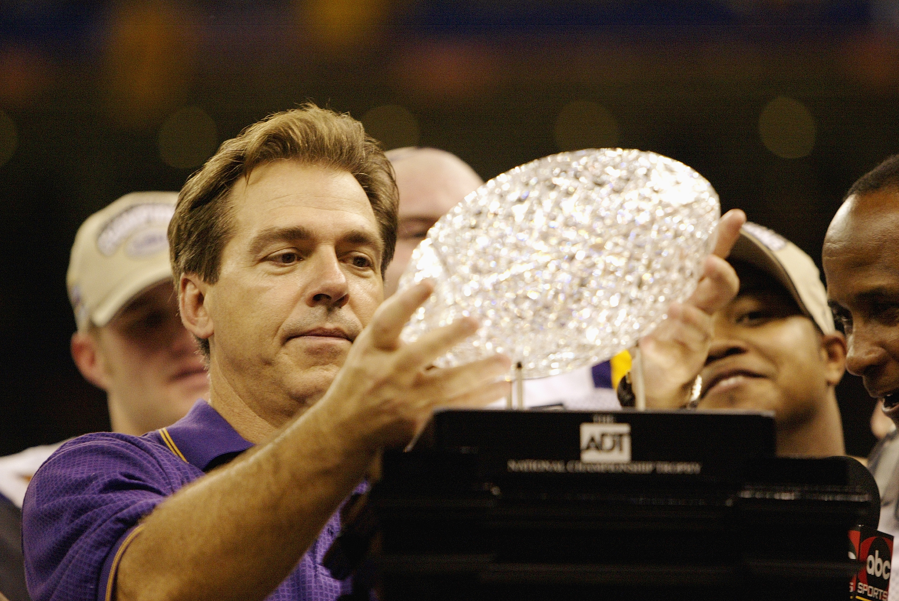 NEW ORLEANS - JANUARY 4:  Head coach Nick Saban of the Loiusiana State Tigers holds up the Bowl Championship Series Trophy after his team defeated the Oklahoma Sooners in the Nokia Sugar Bowl National Championship on January 4, 2004 at the Louisiana Super