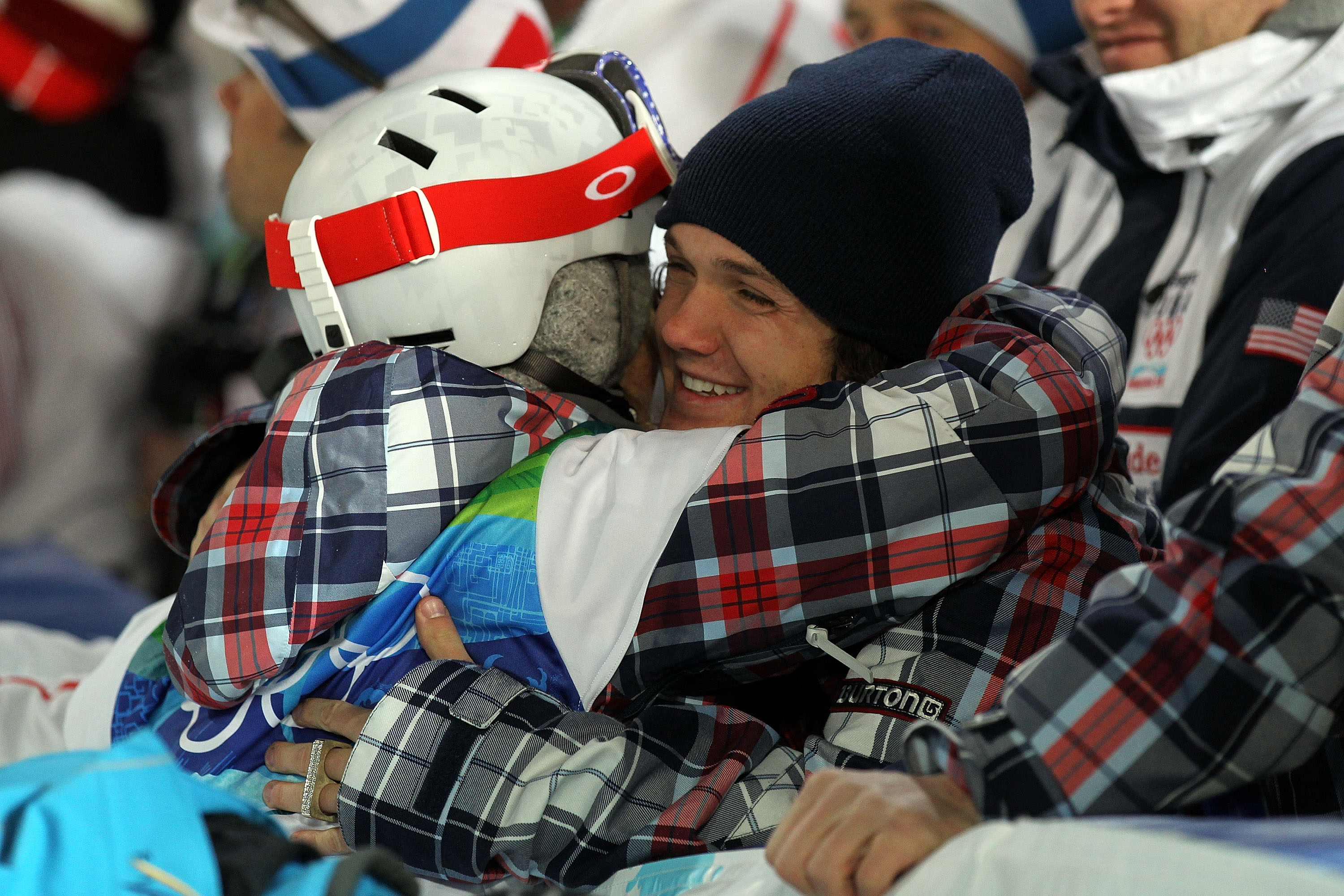VANCOUVER, BC - FEBRUARY 18: Team USA Men's snowboard team member Louie Vito consoles Gretchen Bleiler of the United States during the women's snowboard halfpipe final on day seven of the Vancouver 2010 Winter Olympics at Cypress Snowboard & Ski-Cross Sta