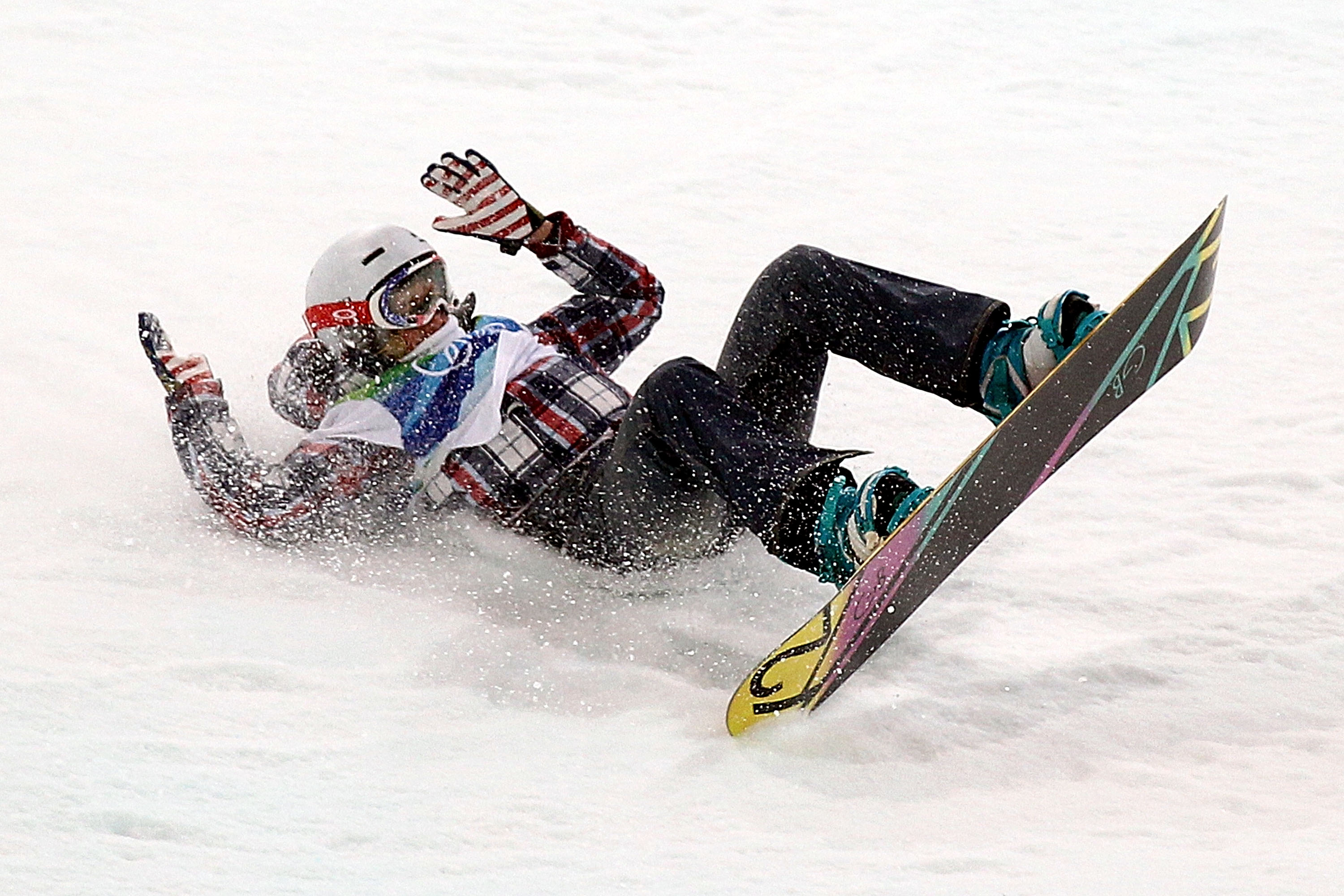 VANCOUVER, BC - FEBRUARY 18:  Gretchen Bleiler of the United States crashes on her second run during the the women's snowboard halfpipe final on day seven of the Vancouver 2010 Winter Olympics at Cypress Snowboard & Ski-Cross Stadium on February 18, 2010