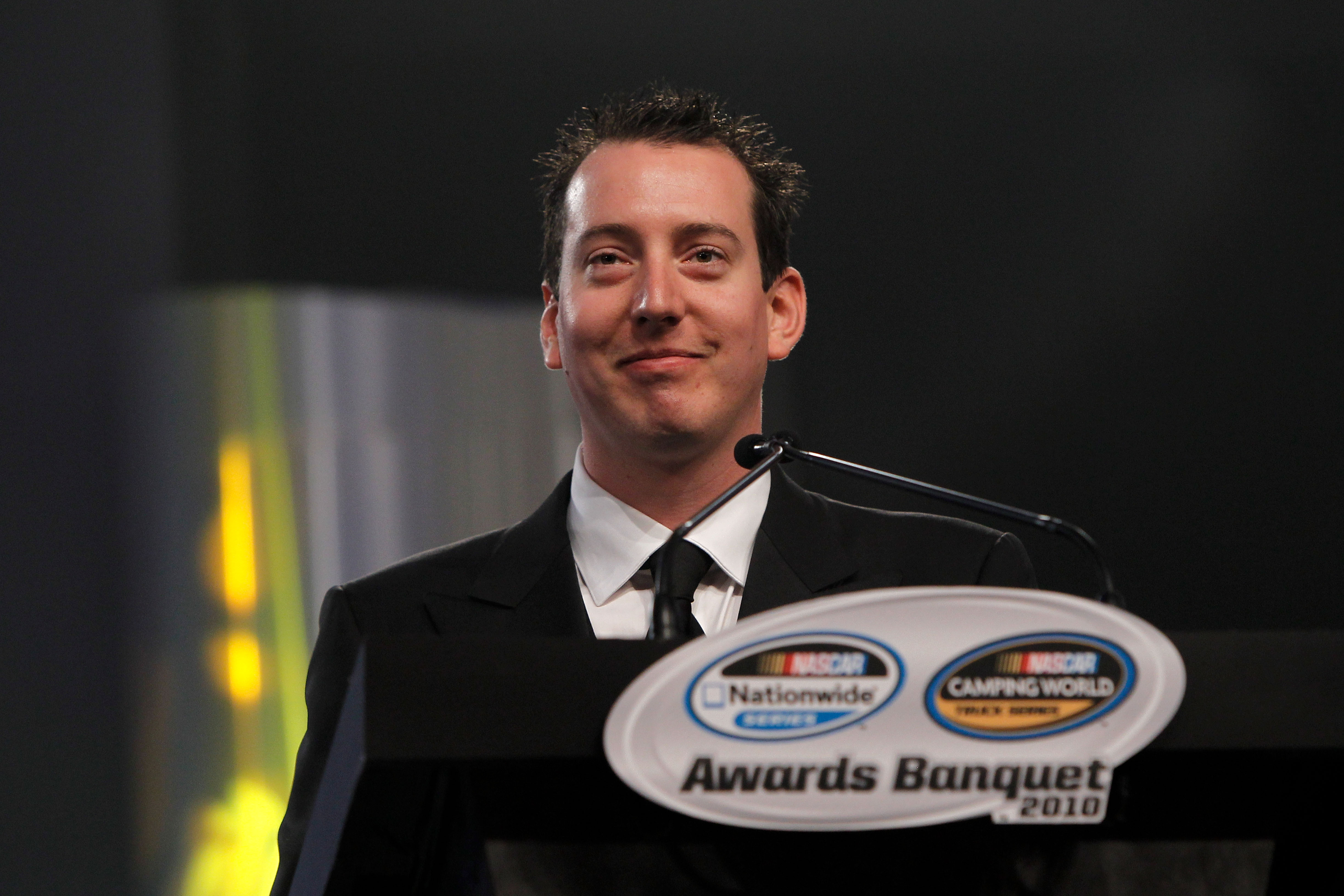 MIAMI - NOVEMBER 22:  2010 Owner Champion Kyle Busch, driver of the #18 Z-Line Designs Toyota, speaks during the NASCAR Nationwide/Camping World Truck Series Banquet at Loews Miami Beach Hotel on November 22, 2010 in Miami, Florida.  (Photo by Chris Trotm