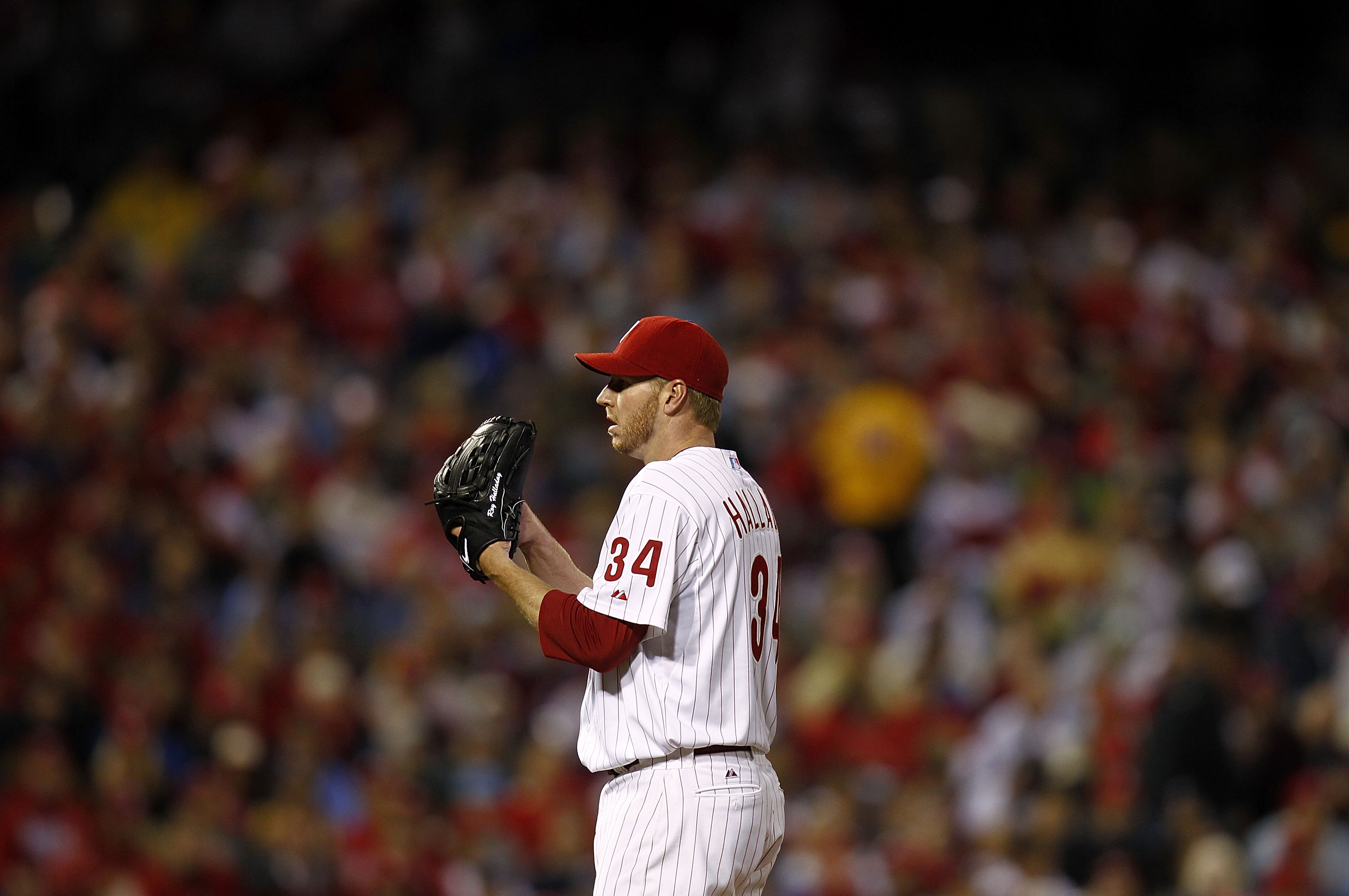 PHILADELPHIA - OCTOBER 06:  Roy Halladay #34 of the Philadelphia Phillies delivers in Game 1 of the NLDS against the Cincinnati Reds at Citizens Bank Park on October 6, 2010 in Philadelphia, Pennsylvania.  (Photo by Jeff Zelevansky/Getty Images)