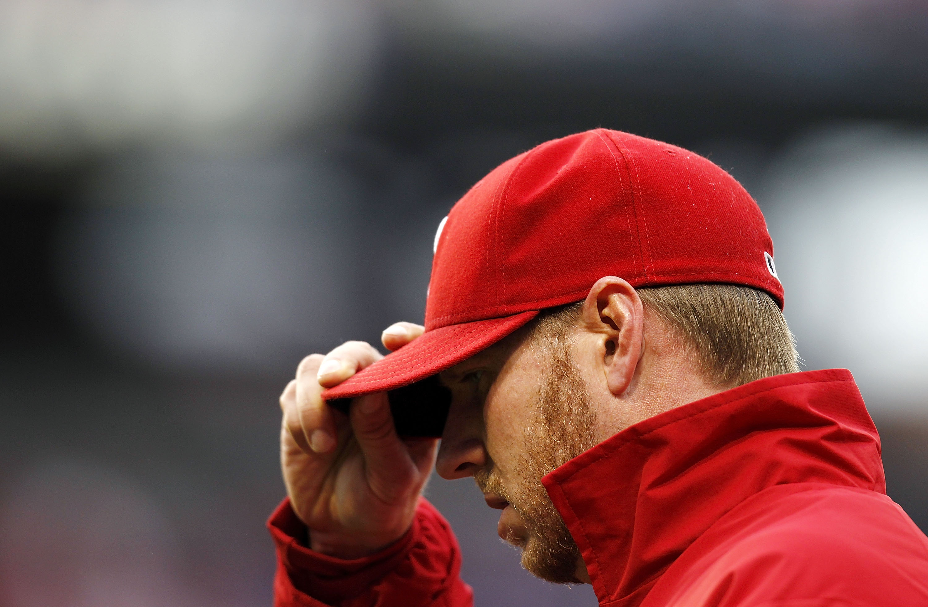 PHILADELPHIA - OCTOBER 06:  Roy Halladay #34 of the Philadelphia Phillies walks to the dugout in Game 1 of the NLDS against the Cincinnati Reds at Citizens Bank Park on October 6, 2010 in Philadelphia, Pennsylvania.  (Photo by Jeff Zelevansky/Getty Images
