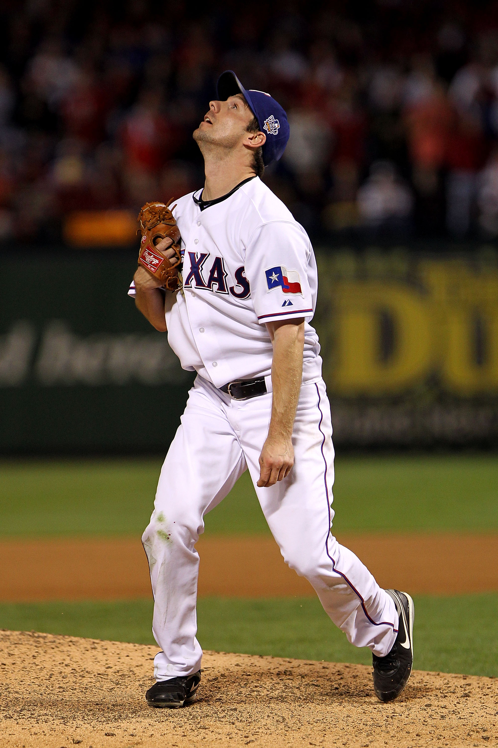 ARLINGTON, TX - NOVEMBER 01:  Cliff Lee #33 of the Texas Rangers watches a 3-run home run hit by Edgar Renteria #16 of the San Francisco Giants leave the ballpark in Game Five of the 2010 MLB World Series at Rangers Ballpark in Arlington on November 1, 20