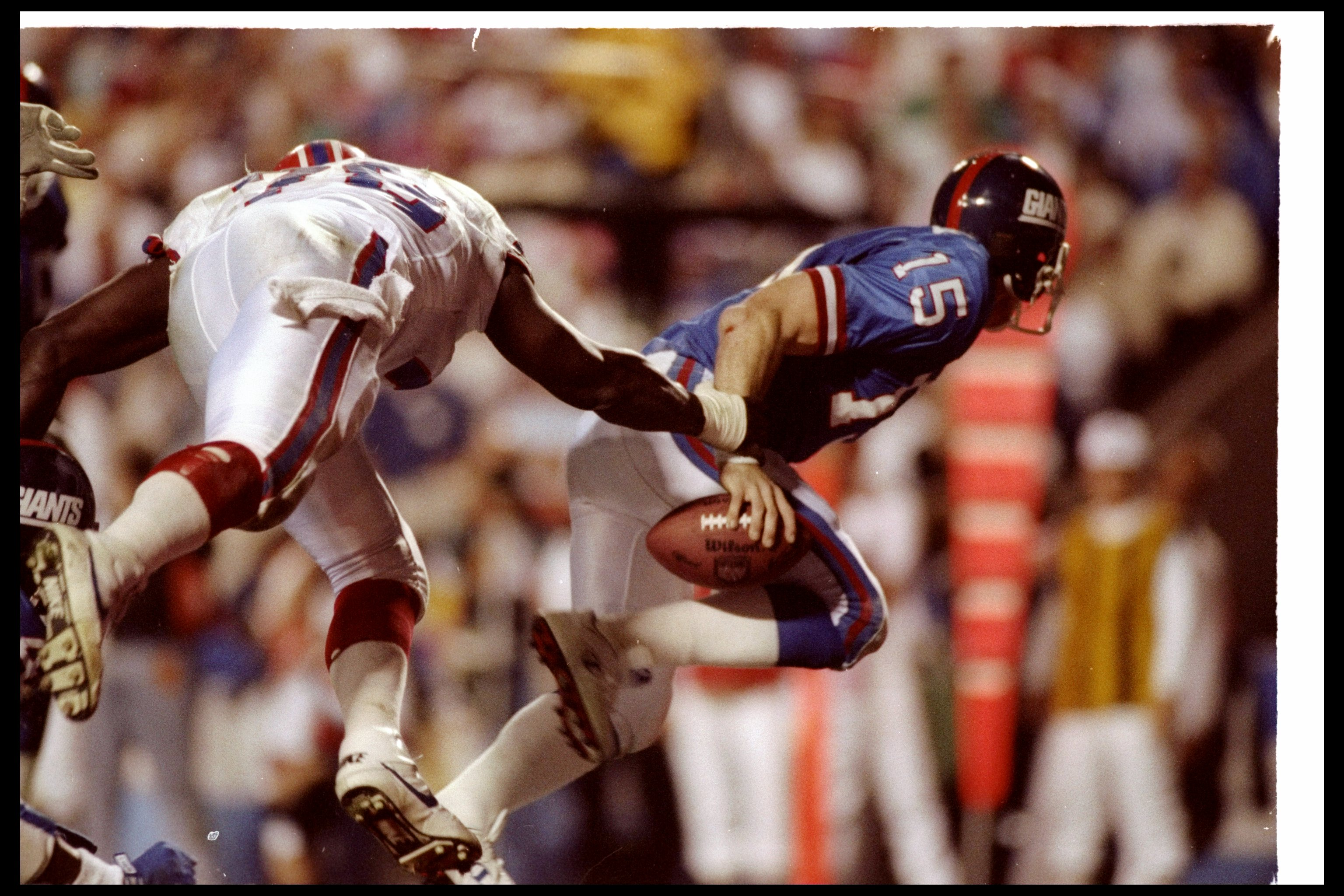 27 Jan 1991:  Quarterback Jeff Hostetler of the New York Giants gets sacked during Super Bowl XXV against the Buffalo Bills at Tampa Stadium in Tampa, Florida.  The Giants won the game, 20-19. Mandatory Credit: Mike Powell  /Allsport