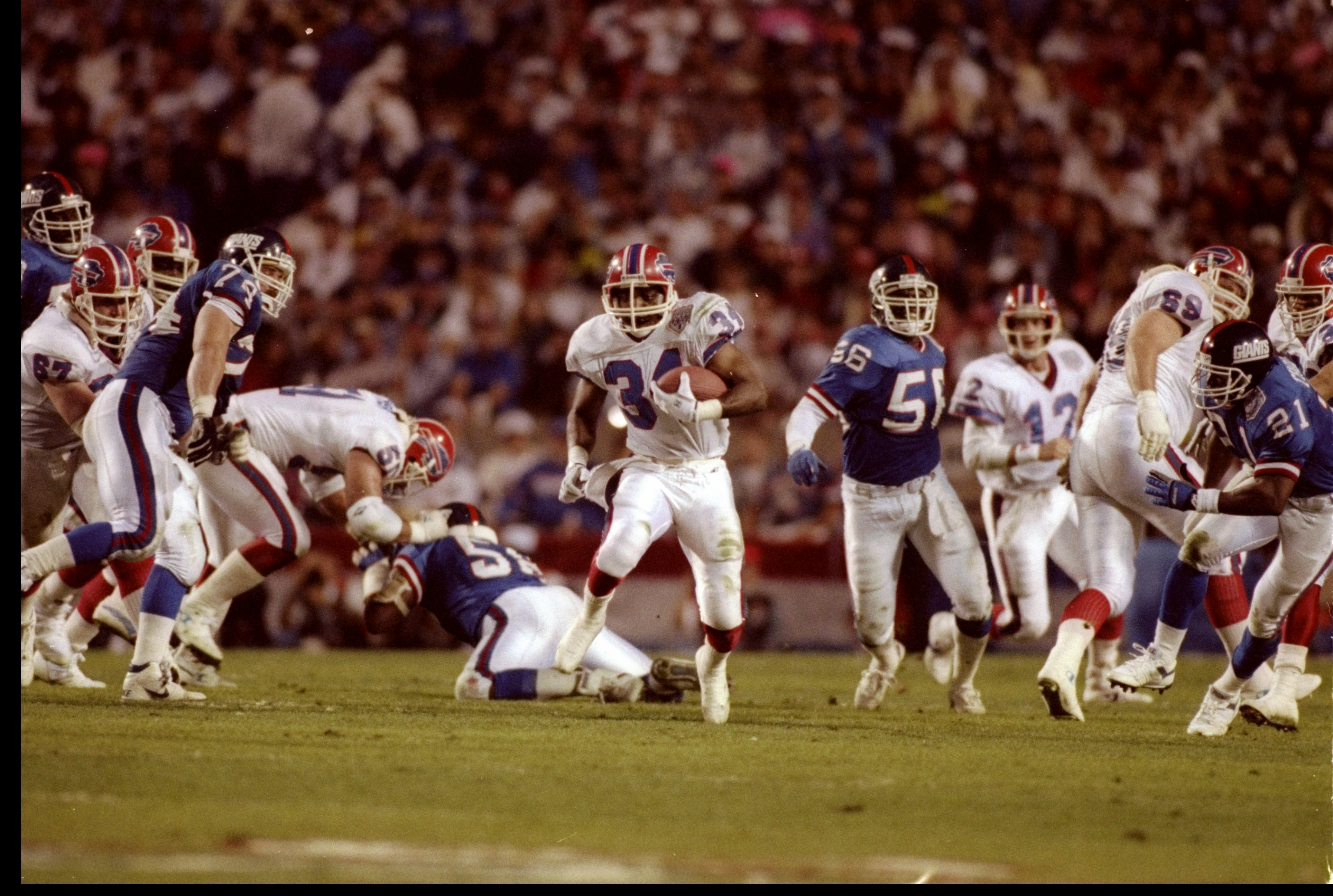 27 Jan 1991:  Running back Thurman Thomas of the Buffalo Bills moves the ball during Super Bowl XXV against the New York Giants at Tampa Stadium in Tampa, Florida.  The Giants won the game, 20-19. Mandatory Credit: Rick Stewart  /Allsport