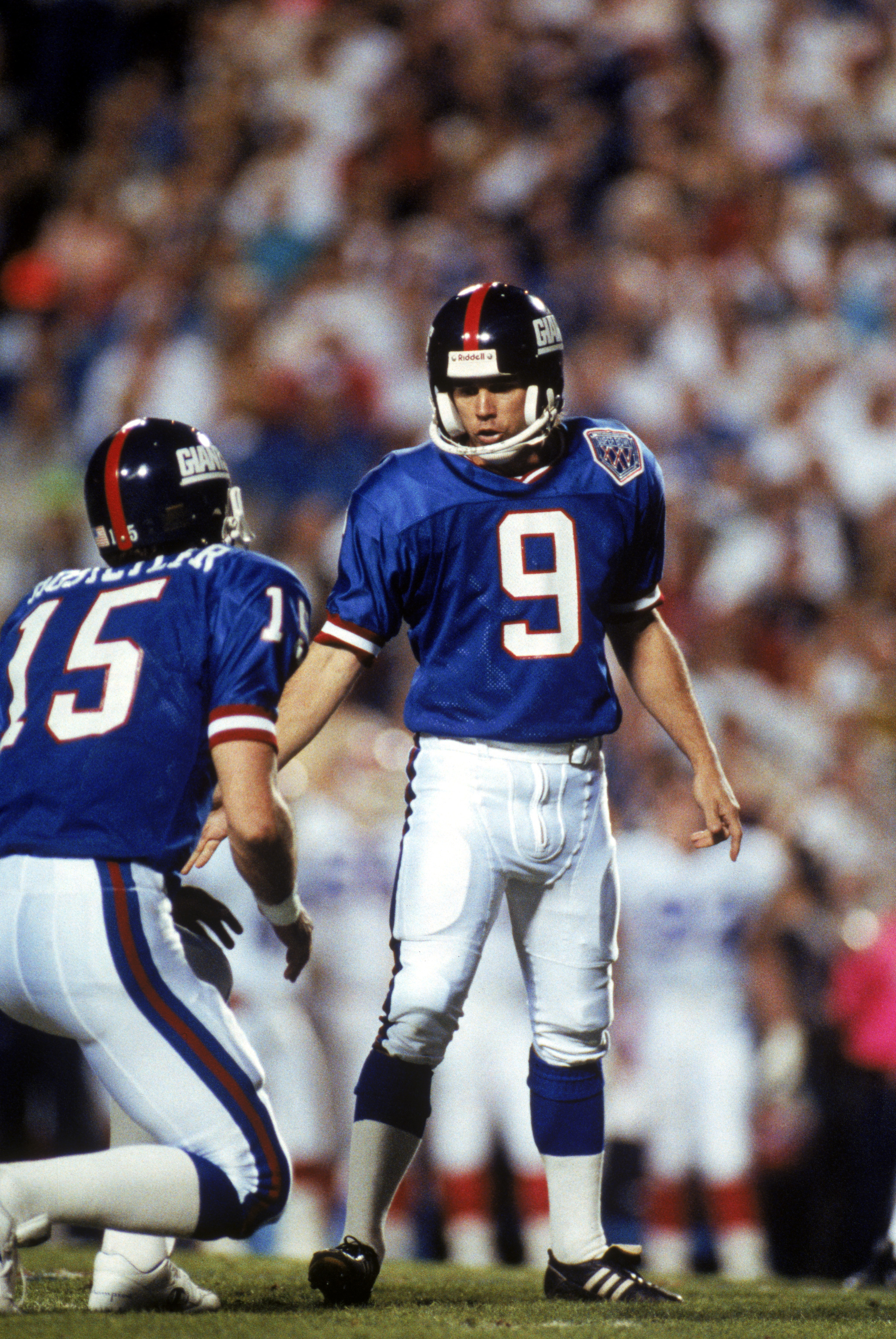 TAMPA, FL - JANUARY 27:  Kicker Matt Bahr #9 and holder Jeff Hostetler #15 of the New York Giants react after Bahr kicked a field goal against the Buffalo Bills during Super Bowl XXV at Tampa Stadium on January 27, 1991 in Tampa, Florida. The Giants defea