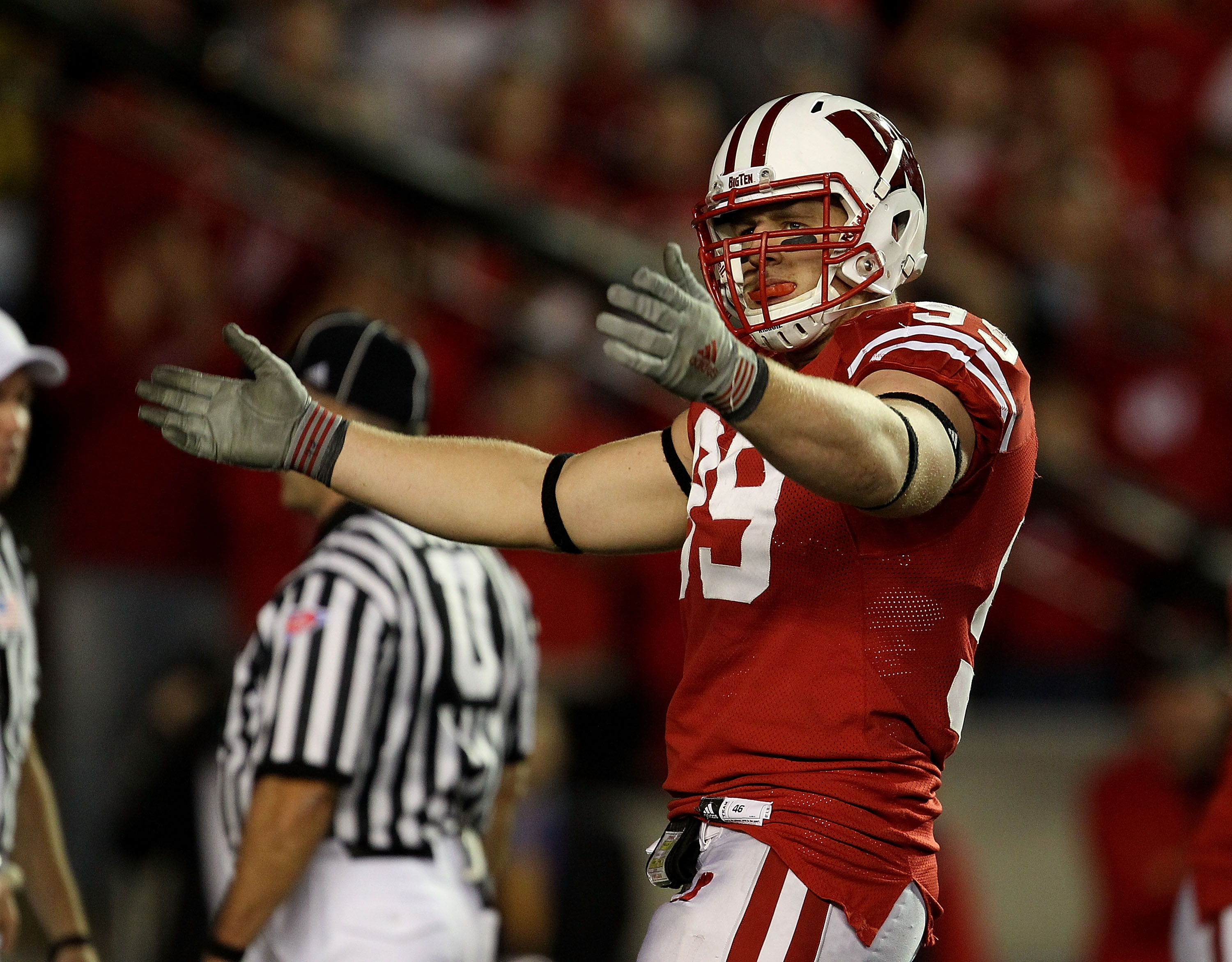 MADISON, WI - OCTOBER 16: J.J. Watt #99 of the Wisconsin Badgers encourages the crowd during a game against the Ohio State Buckeyes at Camp Randall Stadium on October 16, 2010 in Madison, Wisconsin. Wisconsin defeated Ohio State 31-18. (Photo by Jonathan