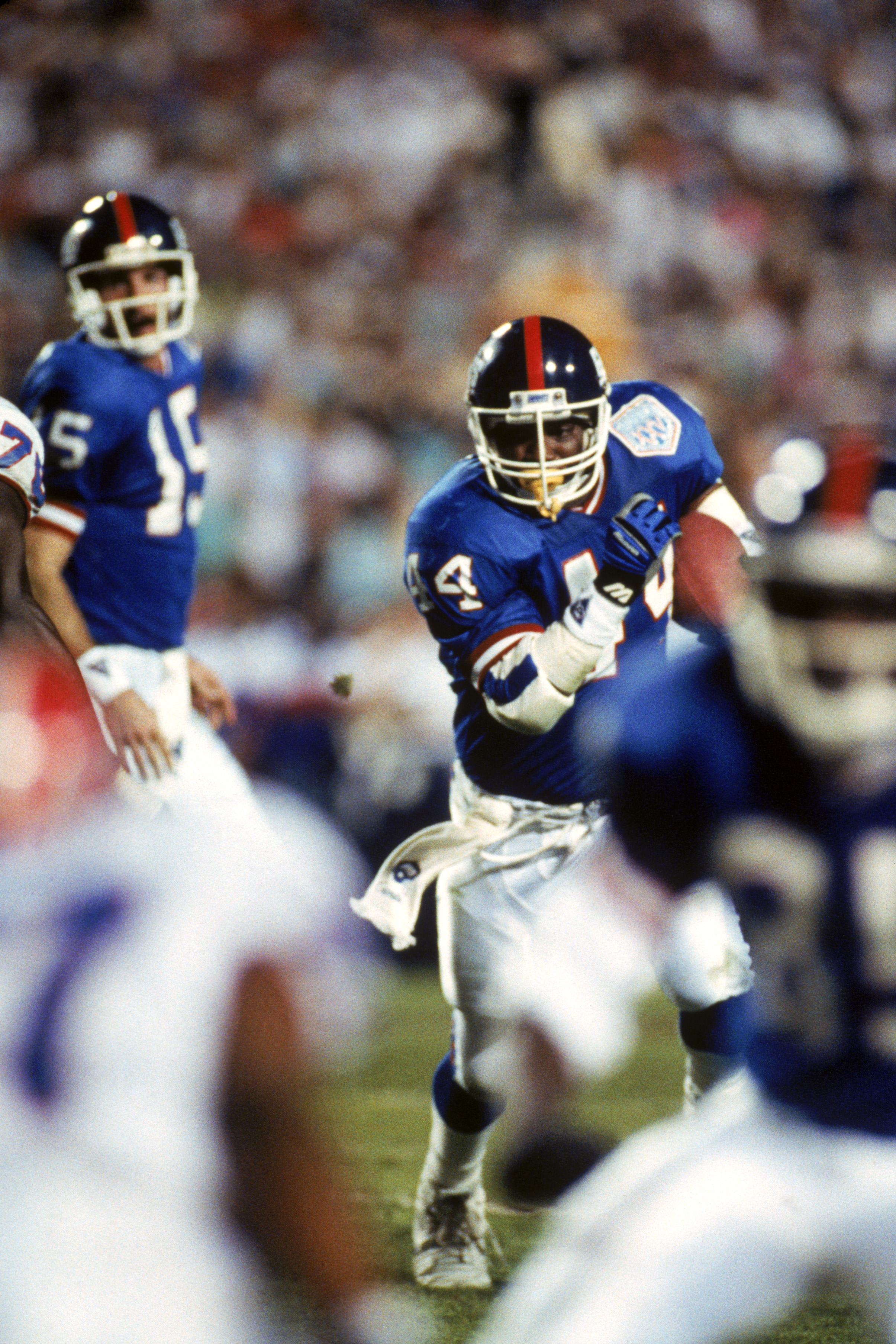 TAMPA, FL - JANUARY 27:  Running back Maurice Carthon #44 of the New York Giants carries the ball against the Buffalo Bills during Super Bowl XXV at Tampa Stadium on January 27, 1991 in Tampa, Florida. The Giants defeated the Bills 20-19.  (Photo by Georg