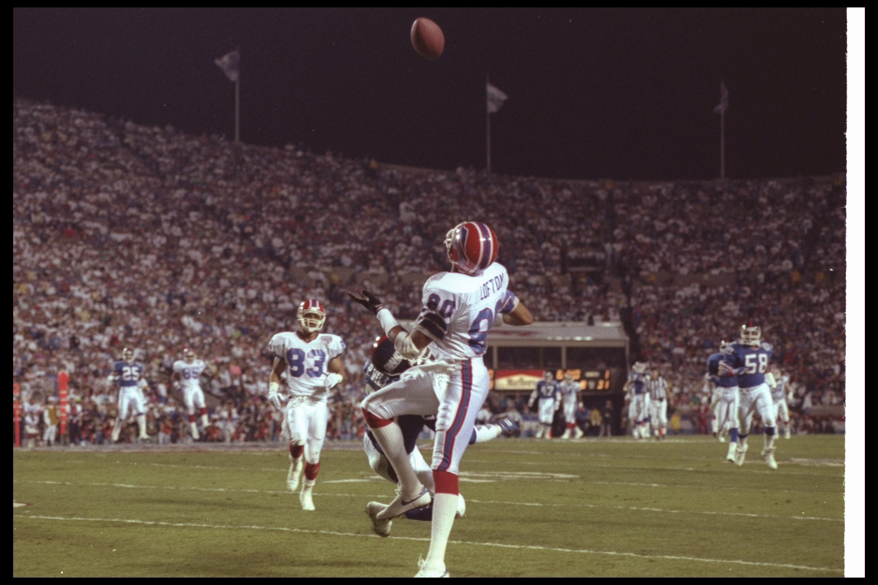 12 Jan 1991: Wide receiver James Lofton of the Buffalo Bills looks for the ball during Super Bowl XXV against the New York Giants at Tampa Stadium in Tampa, Florida. The Giants won the game, 20-19.