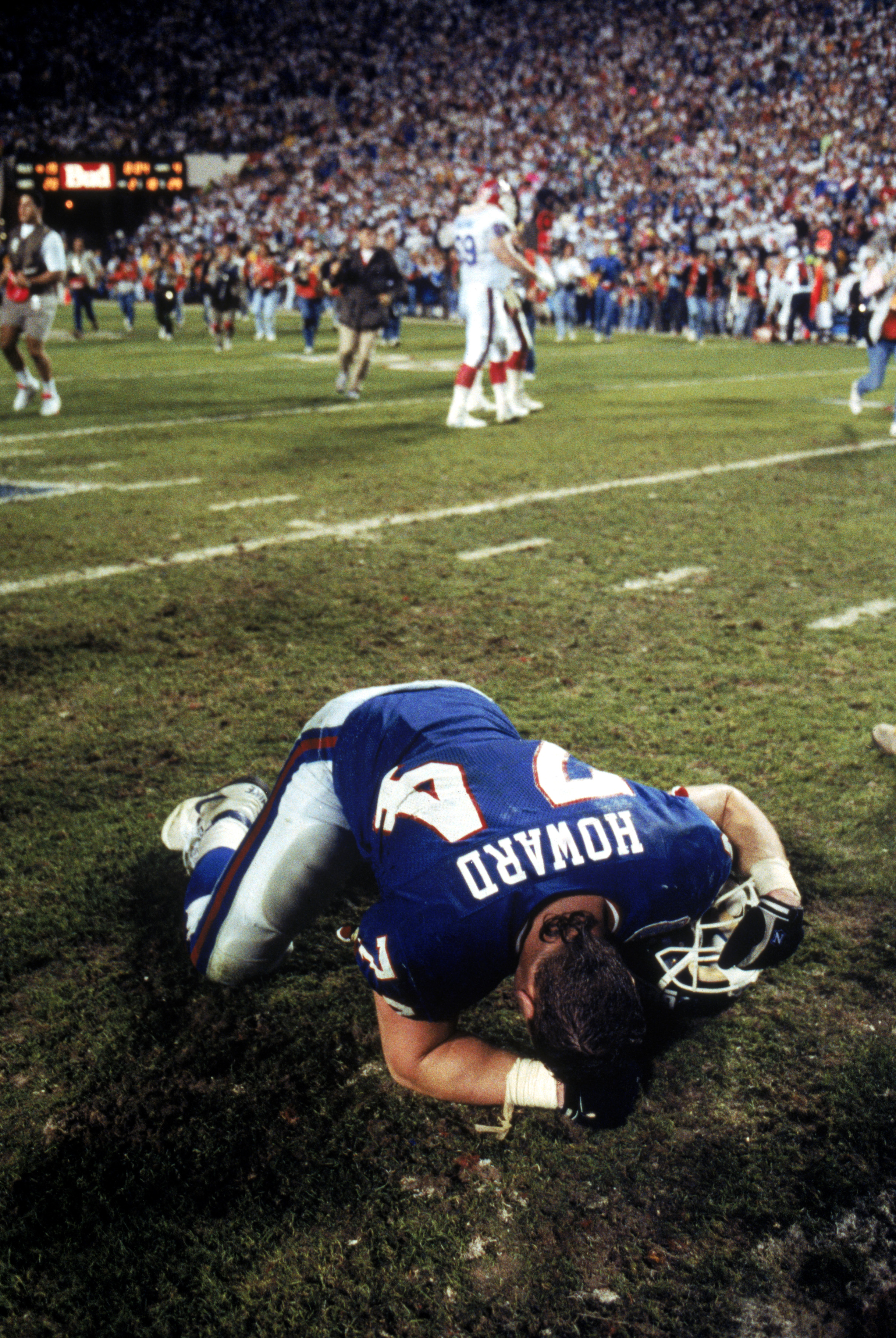TAMPA, FL - JANUARY 27:  Defensive lineman Erik Howard #74 of the New York Giants collapses on the field following the game against the Buffalo Bills during Super Bowl XXV at Tampa Stadium on January 27, 1991 in Tampa, Florida. The Giants defeated the Bil