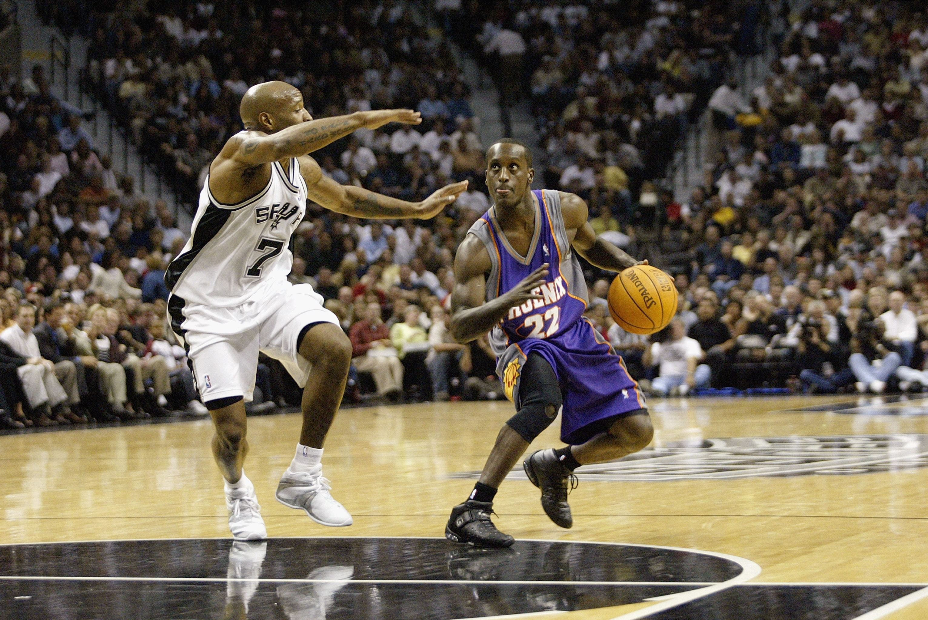 SAN ANTONIO - OCTOBER 28:  Brevin Knight #22 of the Phoenix Suns is defended by Anthony Carter #7 of the San Antonio Spurs on October 28, 2003 at the SBC Center in San Antonio, Texas.  The Spurs won 83-82.  NOTE TO USER: User expressly acknowledges and ag