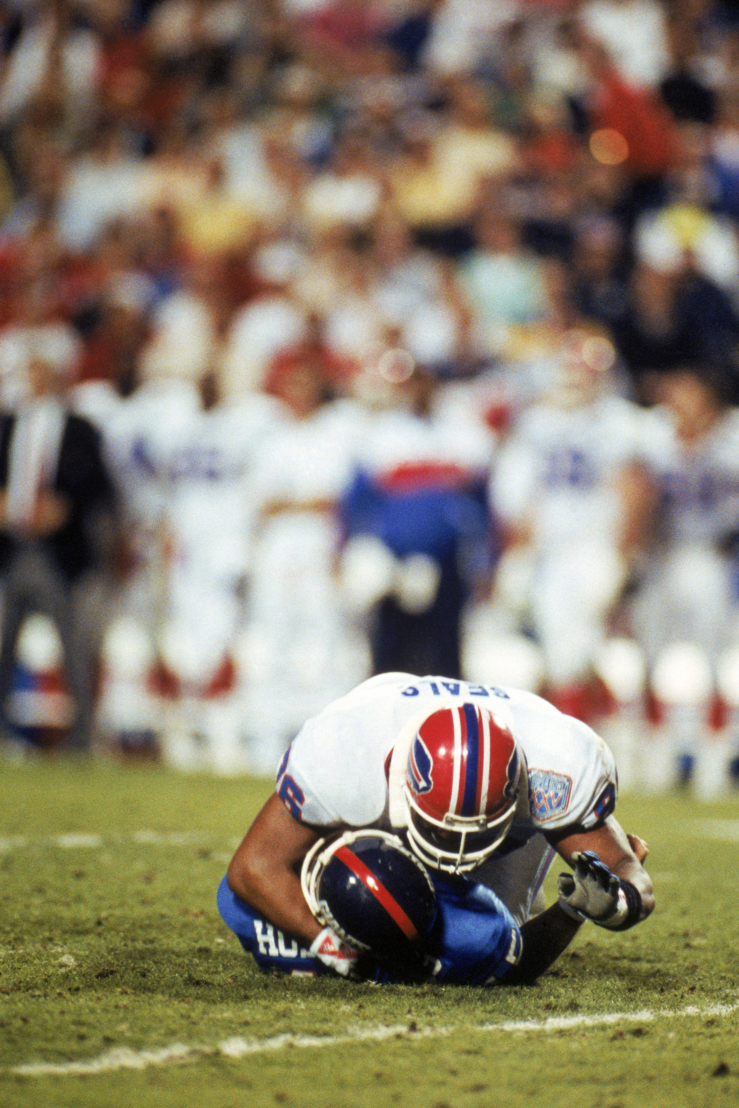 TAMPA, FL - JANUARY 27:  Defensive end Leon Seals #96 of the Buffalo Bills crushes quarterback Jeff Hostetler #15 of the New York Giants after an incomplete pass in the second quarter of Super Bowl XXV at Tampa Stadium on January 27, 1991 in Tampa, Florid