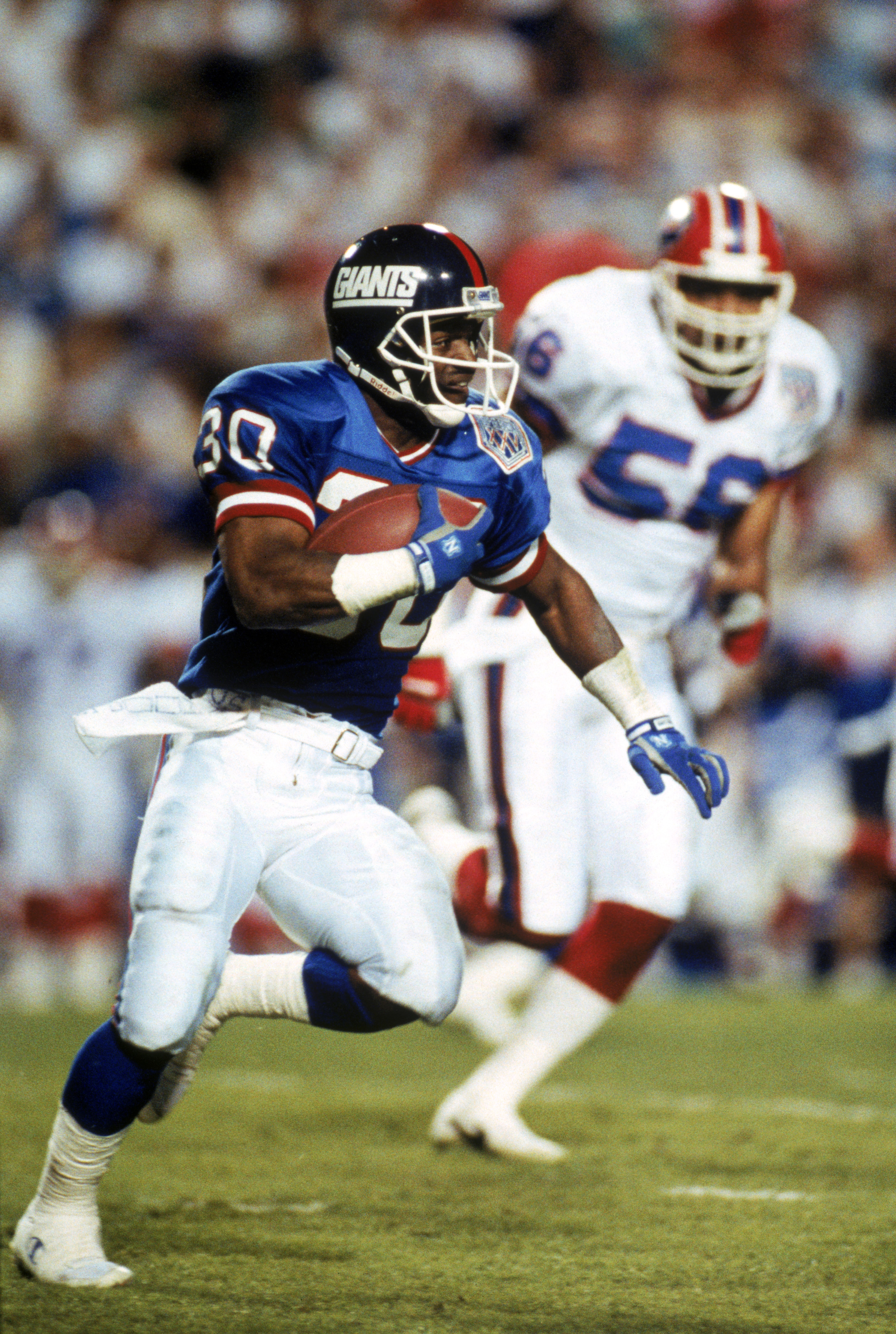 TAMPA, FL - JANUARY 27:  Kick returner Dave Meggett #30 of the New York Giants carries the ball against the Buffalo Bills during Super Bowl XXV at Tampa Stadium on January 27, 1991 in Tampa, Florida. The Giants defeated the Bills 20-19.  (Photo by George