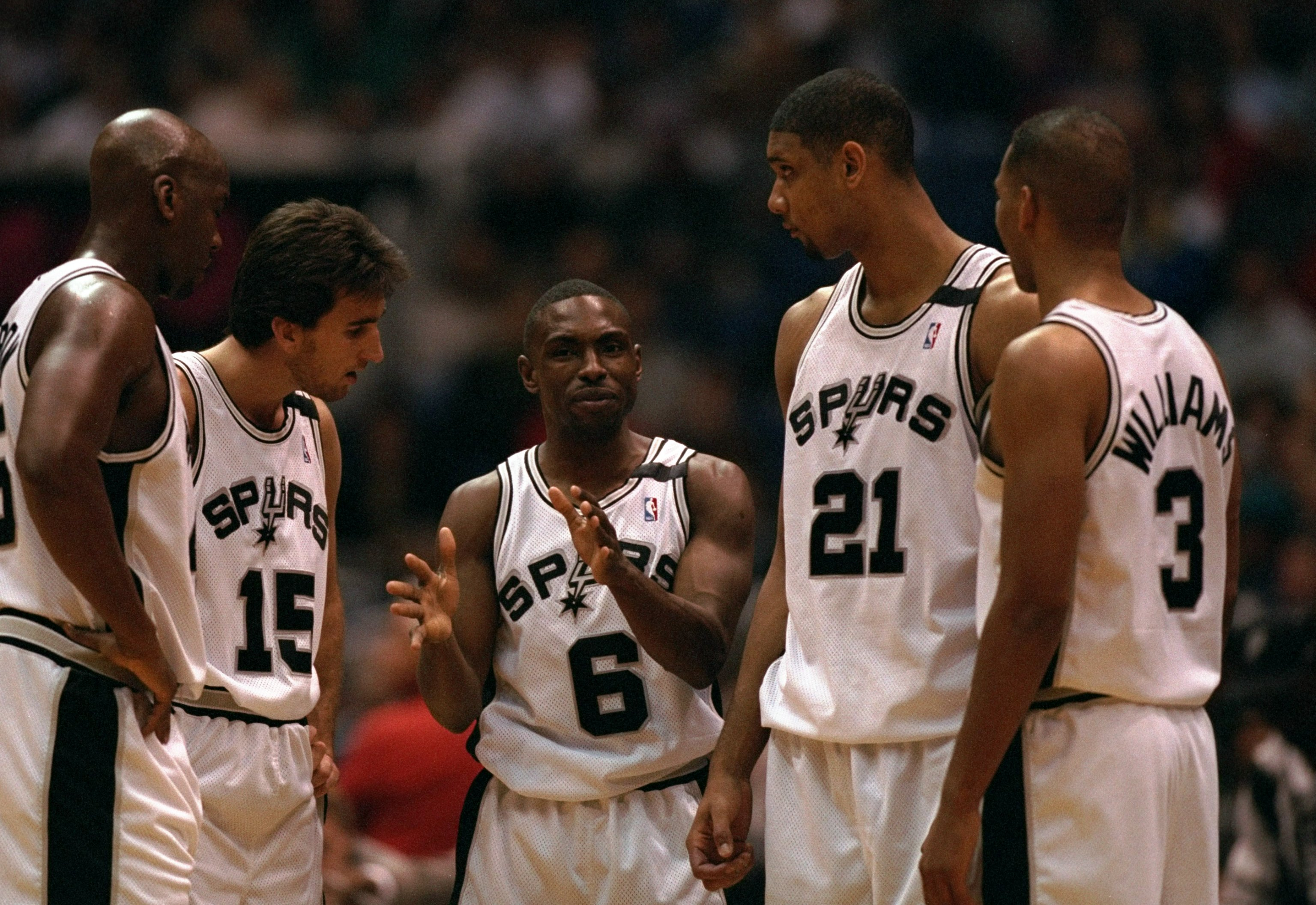 17 Feb 1998:  Guard Avery Johnson of the San Antonio Spurs (center) talks to his teammates during a game against the Detroit Pistons at the Alamodome in San Antonio, Texas.  The Spurs defeated the Pistons 95-94. Mandatory Credit: Andy Lyons  /Allsport