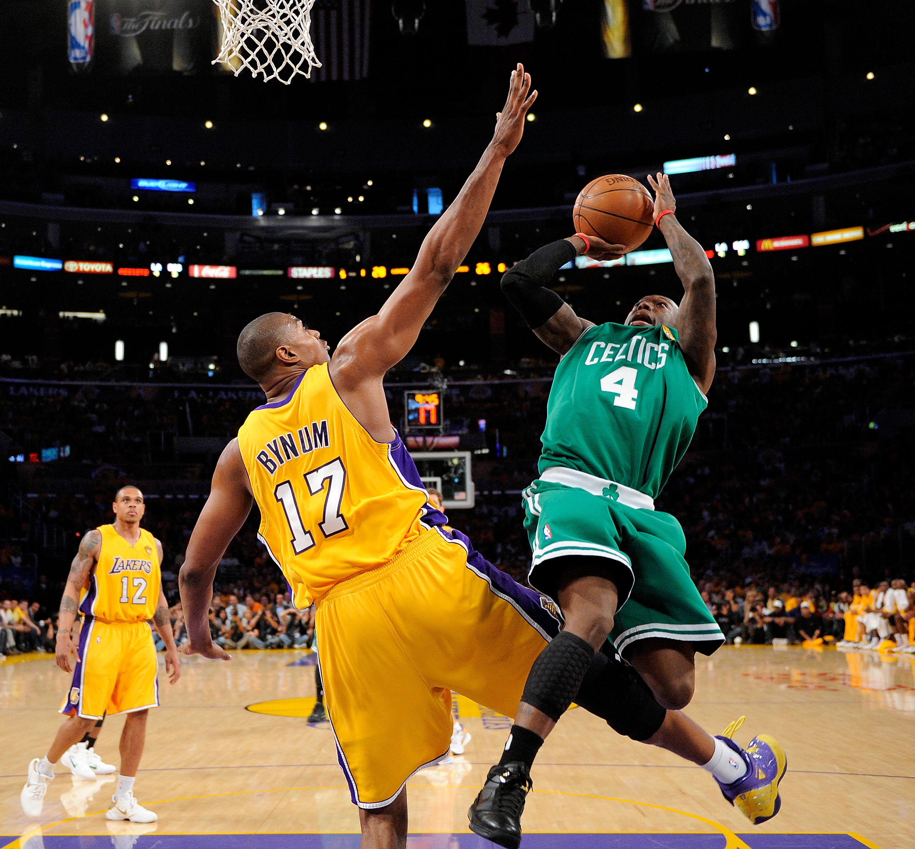 LOS ANGELES - JUNE 3:  Nate Robinson #4 of the Boston Celtics puts a shot up over Andrew Bynum #17 of the Los Angeles Lakers in Game One of the 2010 NBA Finals at Staples Center on June 3, 2010 in Los Angeles, California.  NOTE TO USER: User expressly ack