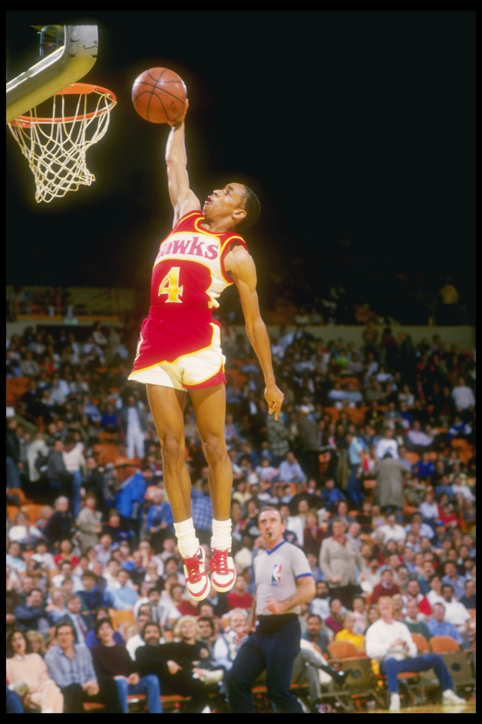 1986-1987:  Guard Anthony (Spud) Webb of the Atlanta Hawks         leaps to victory during a game against the Los Angeles Lakers at The Forum in Inglewood, California. Mandatory Credit: Stephen Dunn  /Allsport