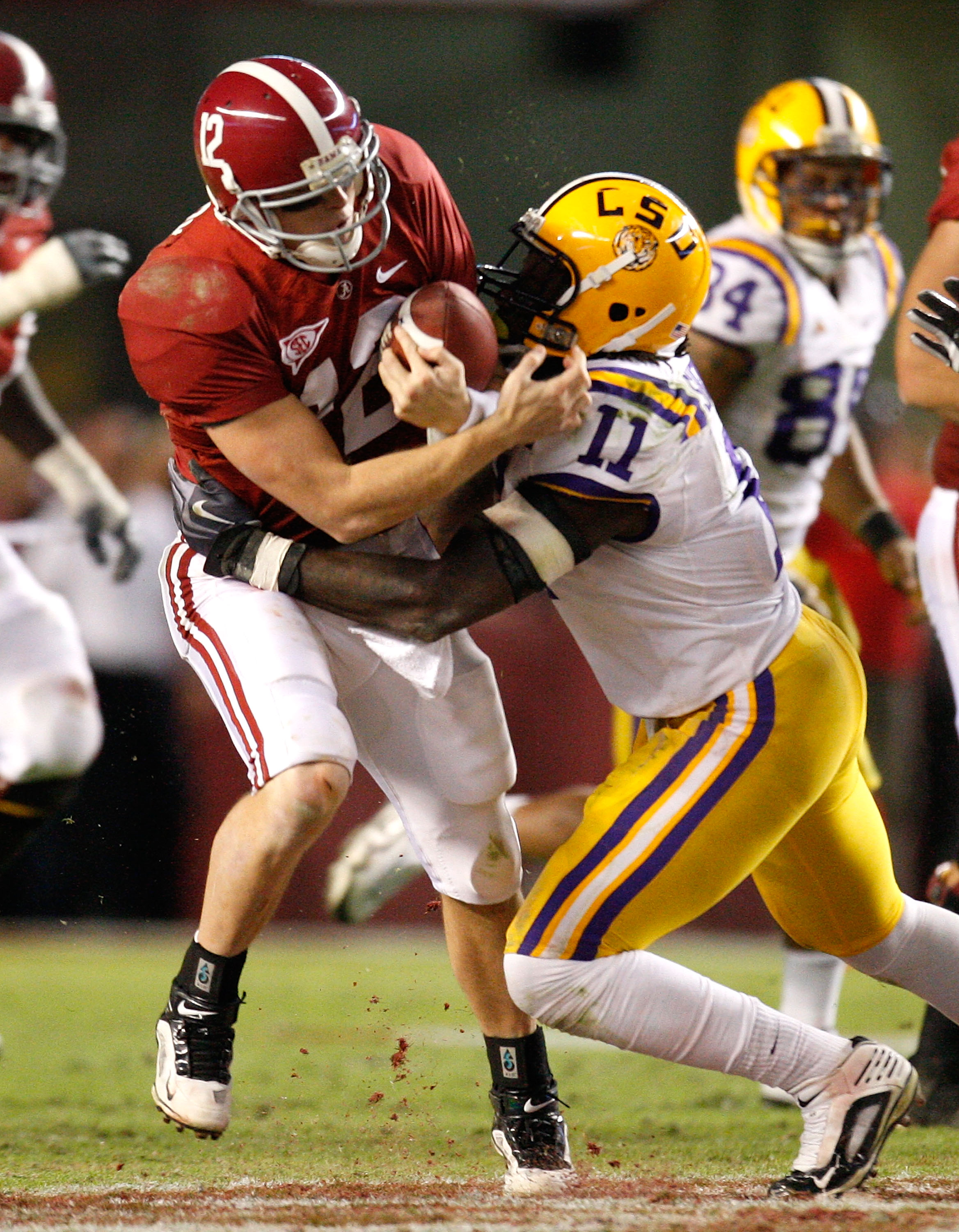 TUSCALOOSA, AL - NOVEMBER 07:  Quarterback Greg McElroy #12 of the Alabama Crimson Tide is tackled by Kelvin Sheppard #11 of the Louisiana State University Tigers at Bryant-Denny Stadium on November 7, 2009 in Tuscaloosa, Alabama.  (Photo by Kevin C. Cox/