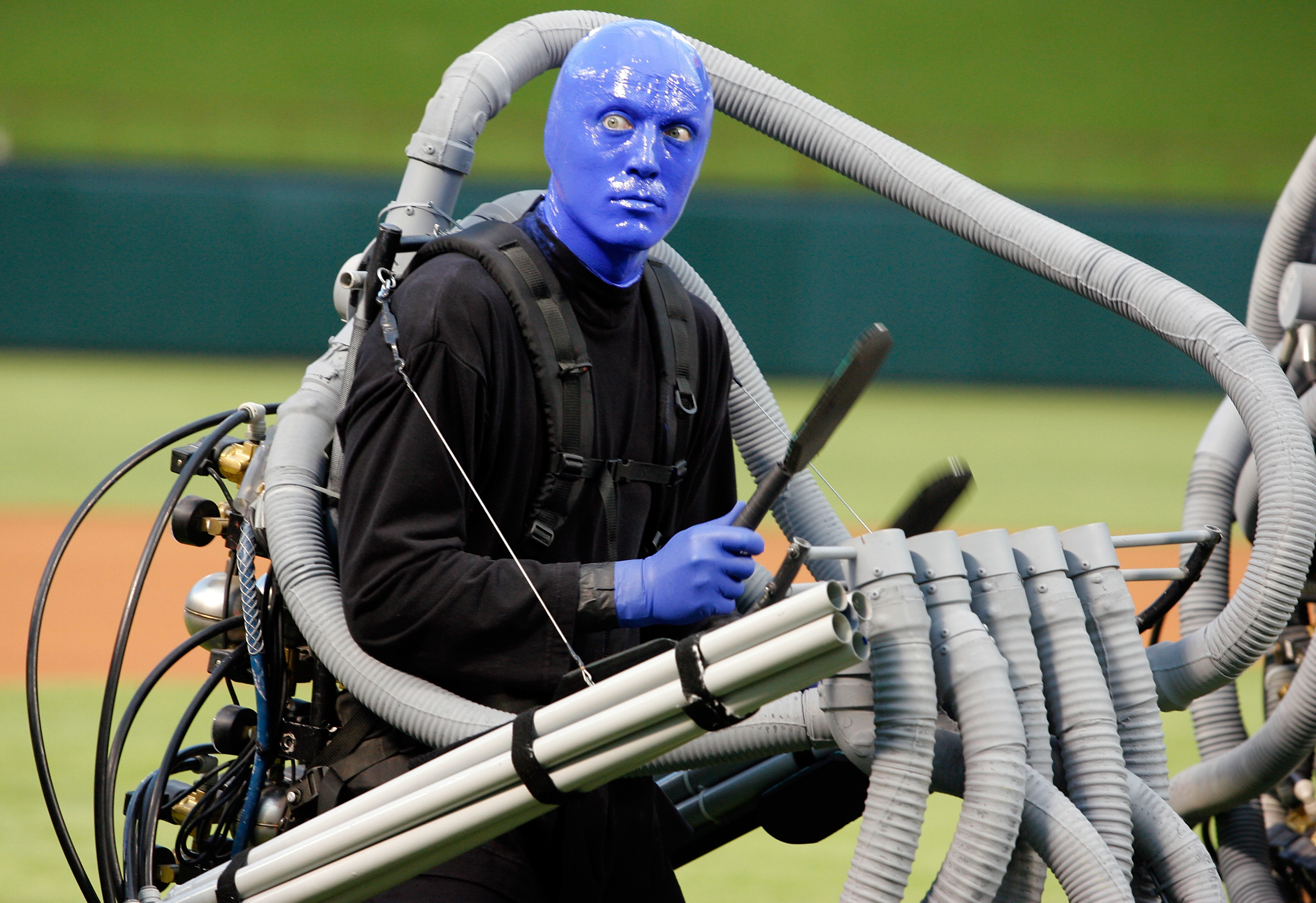 ARLINGTON, TX - SEPTEMBER 10:  A member of Blue Man Group performs the National Anthem before the New York Yankees take on the Texas Rangers on September 10, 2010 at Rangers Ballpark in Arlington, Texas.  (Photo by Tom Pennington/Getty Images)