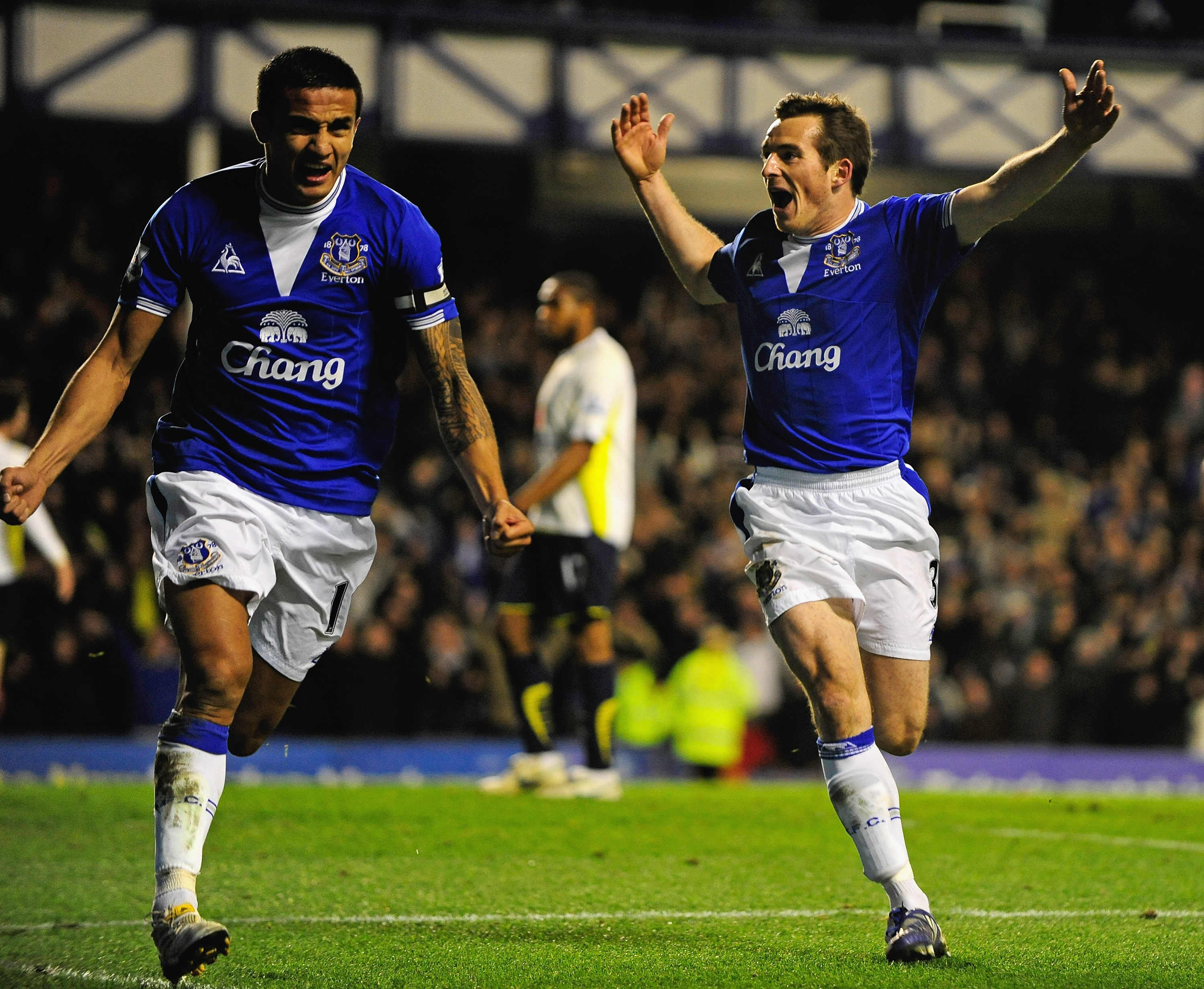 LIVERPOOL, ENGLAND - DECEMBER 06:  Tim Cahill of Everton celebrates scoring his team's second goal with team mate Leighton Baines (R) during the Barclays Premier League match between Everton and Tottenham Hotspur at Goodison Park on December 6, 2009 in Li