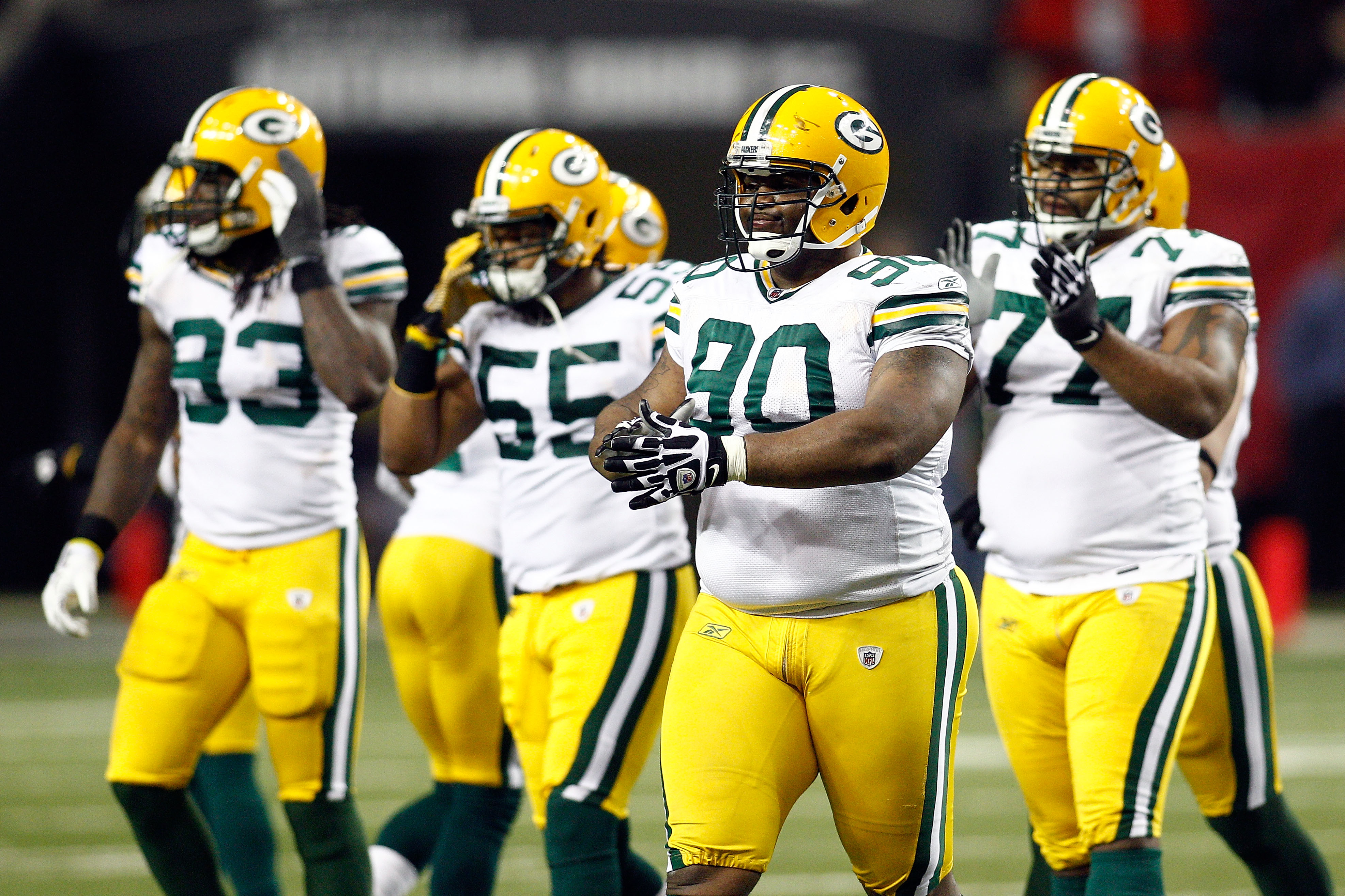 ATLANTA, GA - JANUARY 15:  (L-R) Erik Walden #93, Desmond Bishop #55, B.J. Raji #90 and Cullen Jenkins #77 of the Green Bay Packers walk towards the sideline against the Atlanta Falcons during their 2011 NFC divisional playoff game at Georgia Dome on Janu