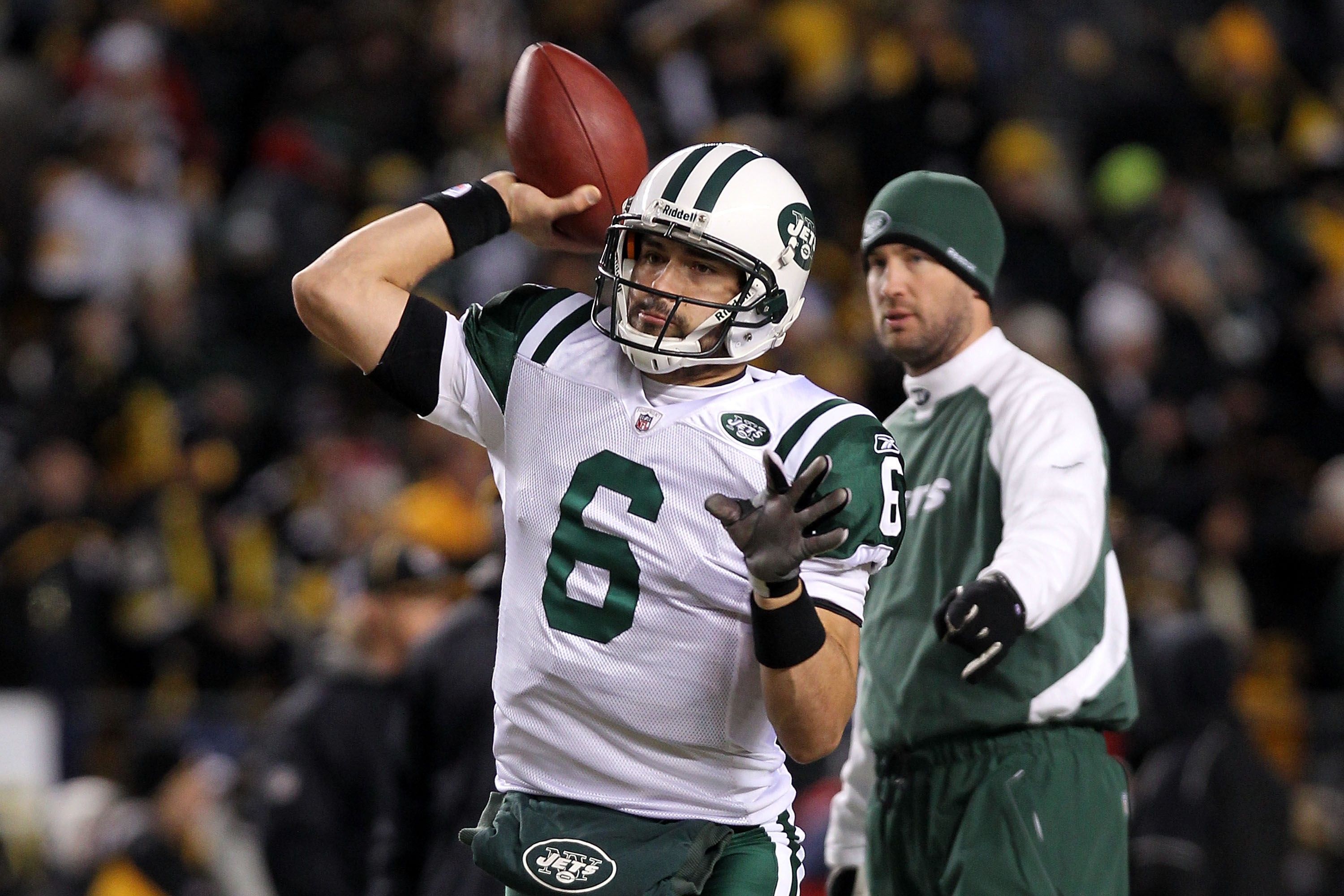 Jets Offensive Coordinator Brian Schottenheimer watches Mark Sanchez