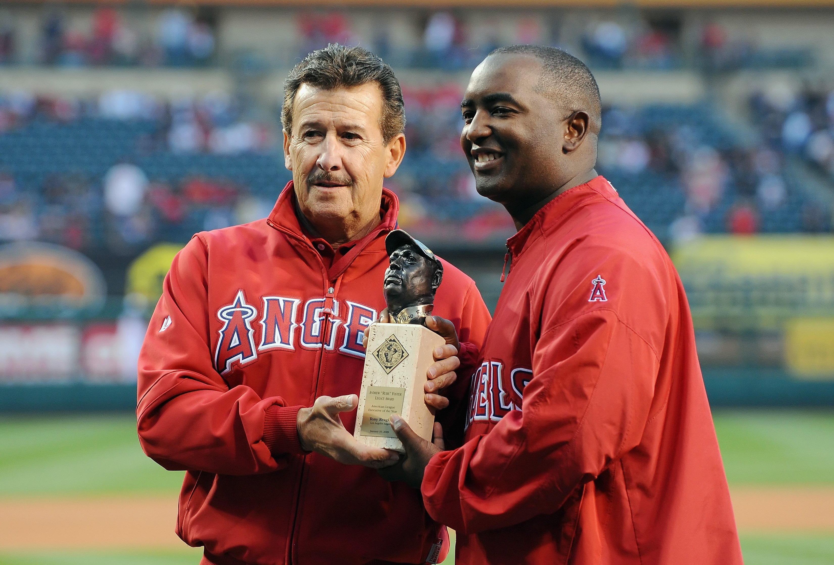 ANAHEIM, CA - APRIL 07:  Owner of the Los Angeles Angels of Anaheim Arturo Moreno presents Tony Reagins with the Andrew Foster Legacy Award before the game against the Oakland Athletics on April 7, 2009 in Anaheim, California.  (Photo by Lisa Blumenfeld/G