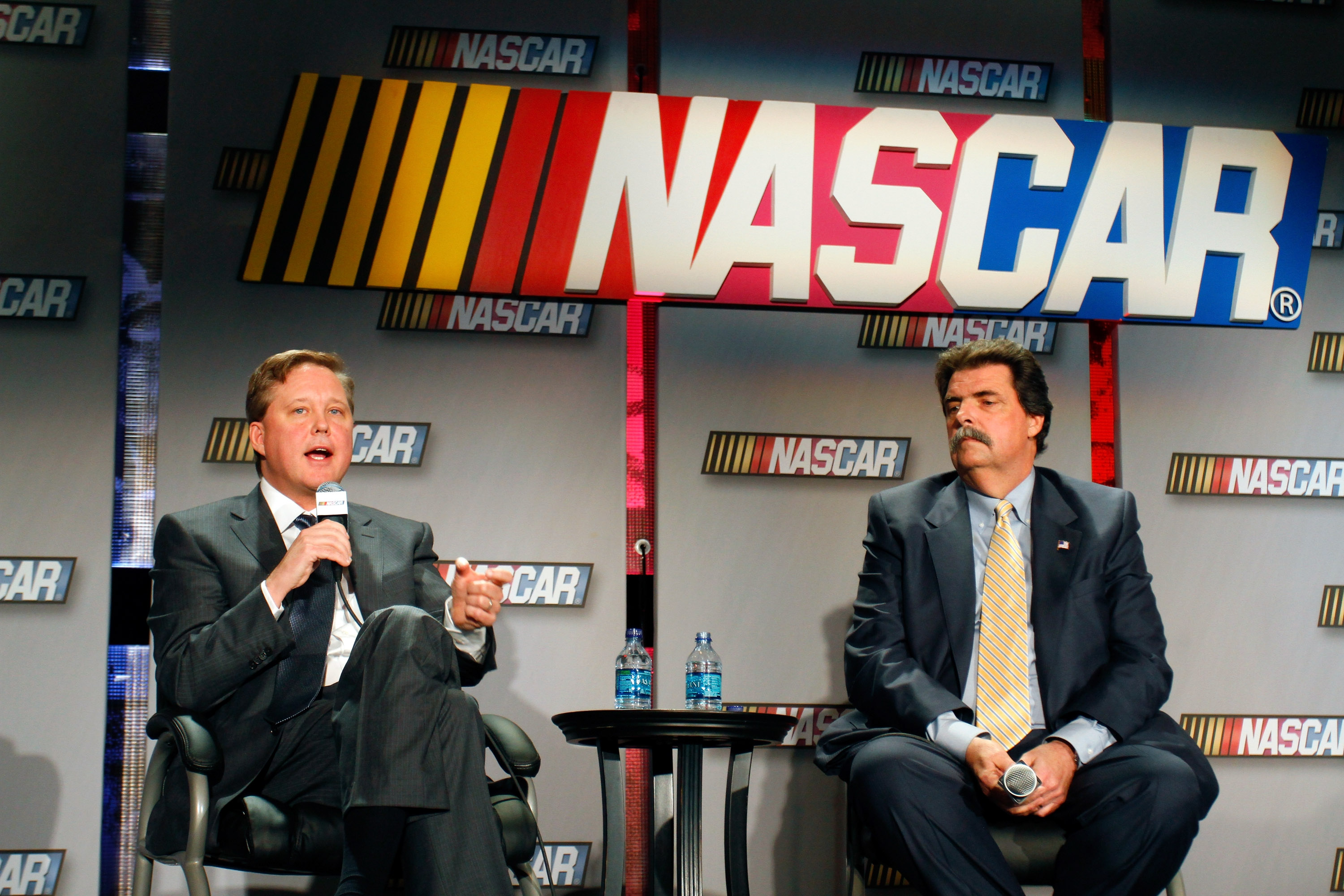 Brian France (left) and Mike Helton might consider the musings of their fans, before their fans cease to be fans.