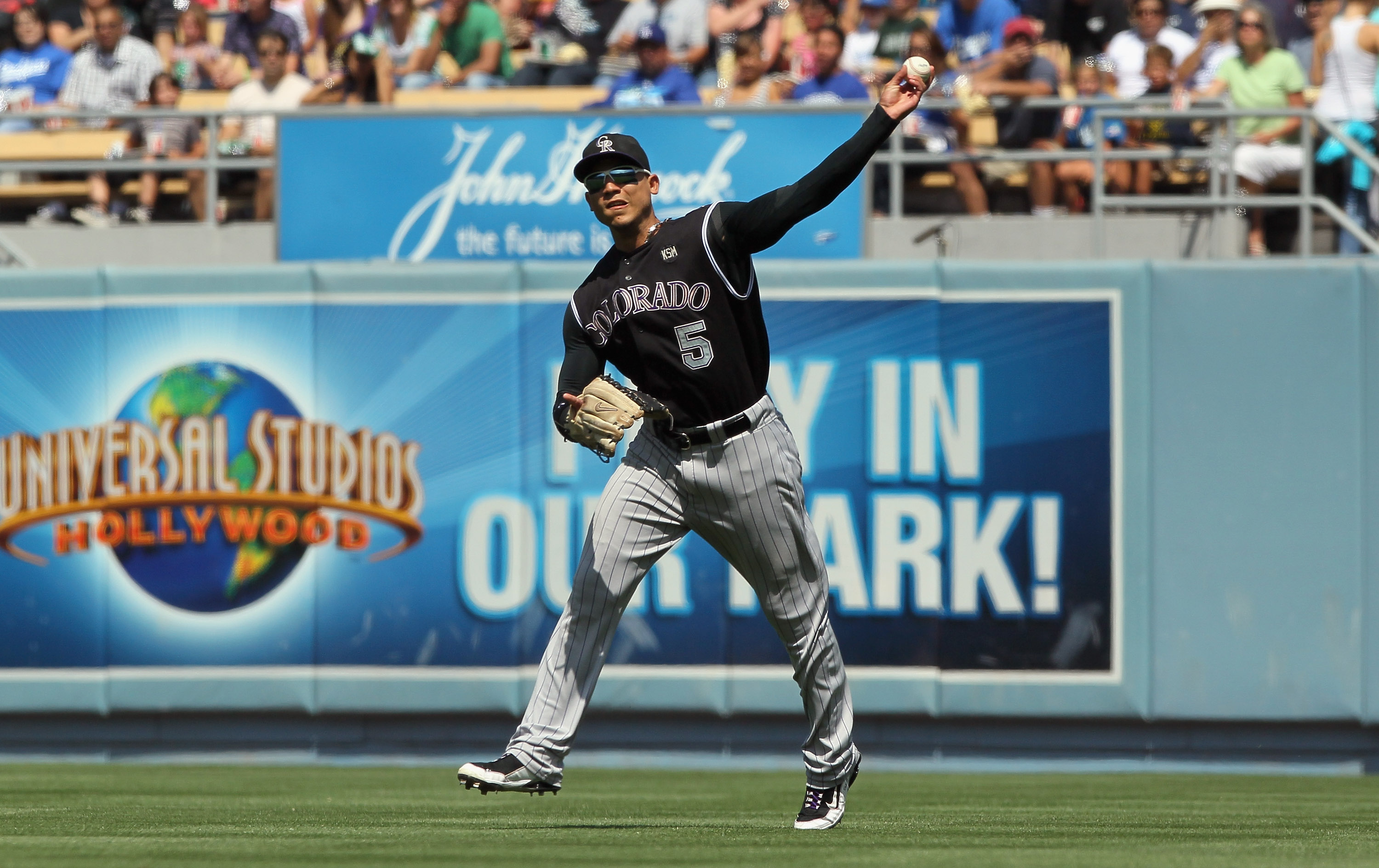 LOS ANGELES, CA - SEPTEMBER 18:  Carlos Gonzalez #5 of the Colorado Rockies plays against the Los Angeles Dodgers in the game at Dodger Stadium on September 18, 2010 in Los Angeles, California.  (Photo by Jeff Gross/Getty Images)