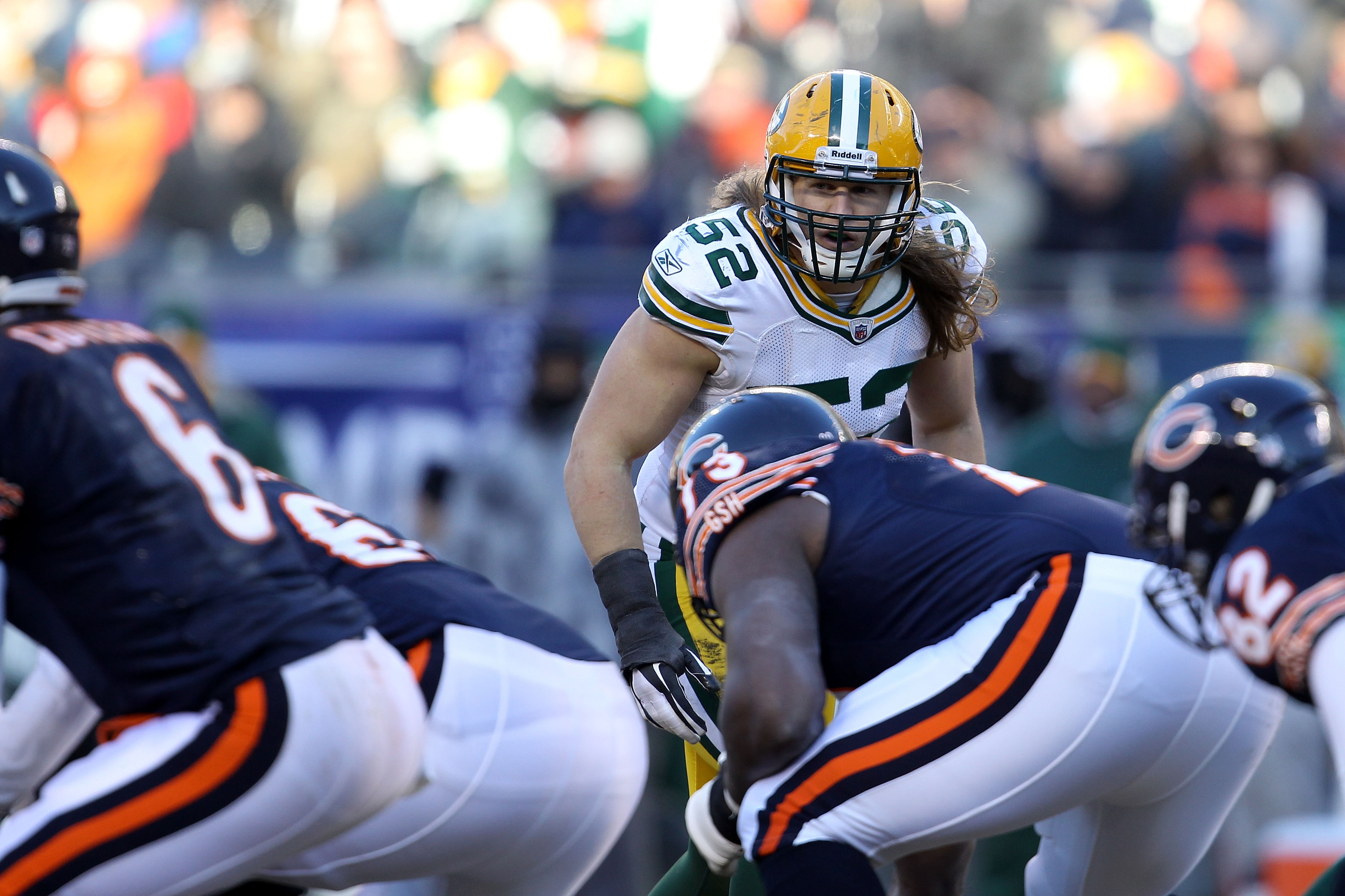 CHICAGO, IL - JANUARY 23:  Linebacker Clay Matthews #52 of the Green Bay Packers looks down the line over at quarterback Jay Cutler #6 of the Chicago Bears in the NFC Championship Game at Soldier Field on January 23, 2011 in Chicago, Illinois.  (Photo by