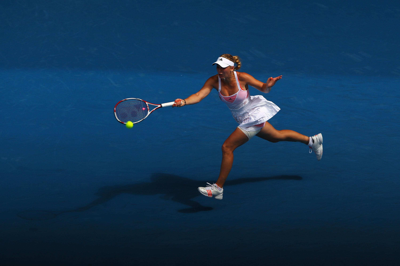 MELBOURNE, AUSTRALIA - JANUARY 25:  Caroline Wozniacki of Denmark plays a forehand during her quarterfinal match against Francesca Schiavone of Italy during day nine of the 2011 Australian Open at Melbourne Park on January 25, 2011 in Melbourne, Australia