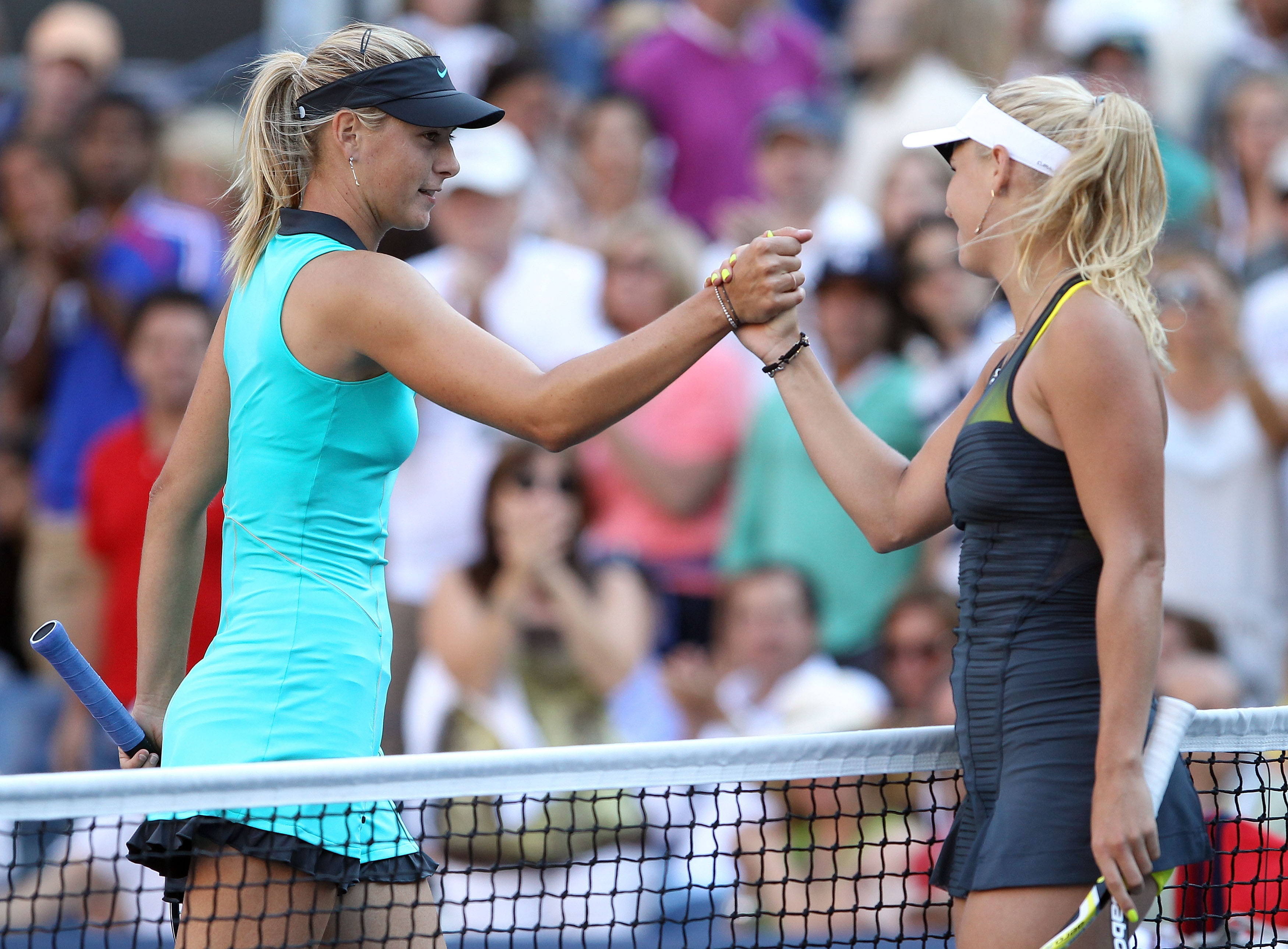 NEW YORK - SEPTEMBER 06:  Maria Sharapova of Russia (L) and Caroline Wozniacki of Denmark (R) shake hands at the net after the women's singles match on day eight of the 2010 U.S. Open at the USTA Billie Jean King National Tennis Center on September 6, 201