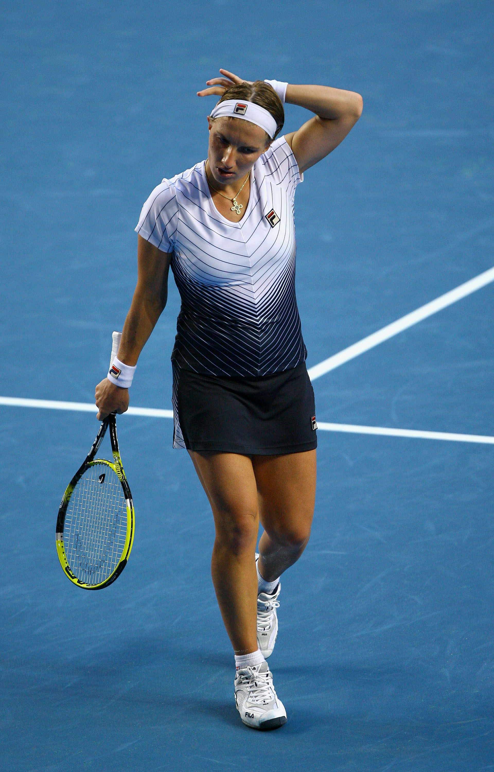 MELBOURNE, AUSTRALIA - JANUARY 23:  Svetlana Kuznetsova of Russia shows emotion after losing her fourth round match against Francesca Schiavone of Italy after a record 4 hours and 44 mins during day seven of the 2011 Australian Open at Melbourne Park on J