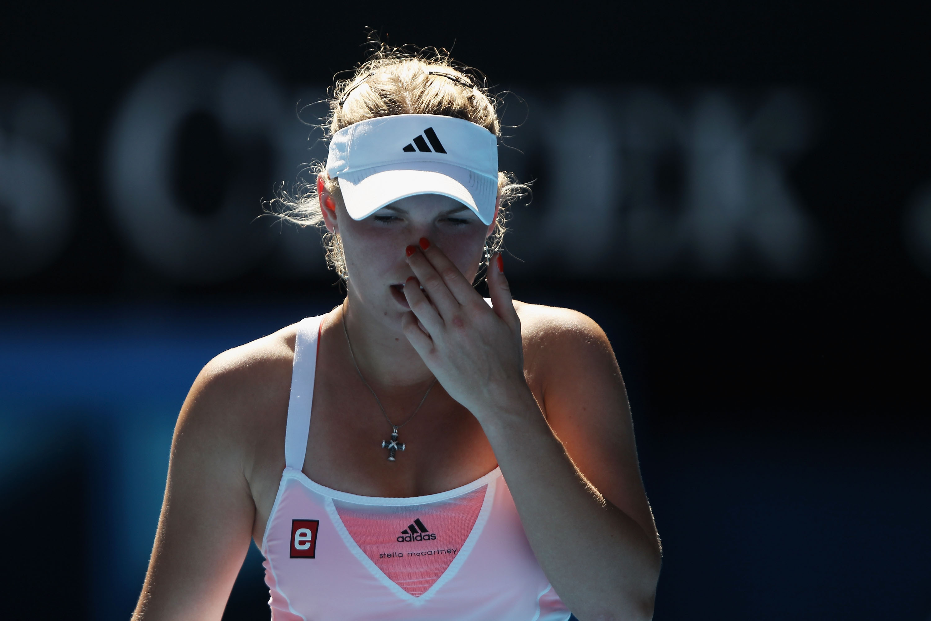 MELBOURNE, AUSTRALIA - JANUARY 27:  Caroline Wozniacki of Denmark looks dejected in her semifinal match against Na Li of China during day eleven of the 2011 Australian Open at Melbourne Park on January 27, 2011 in Melbourne, Australia.  (Photo by Clive Br