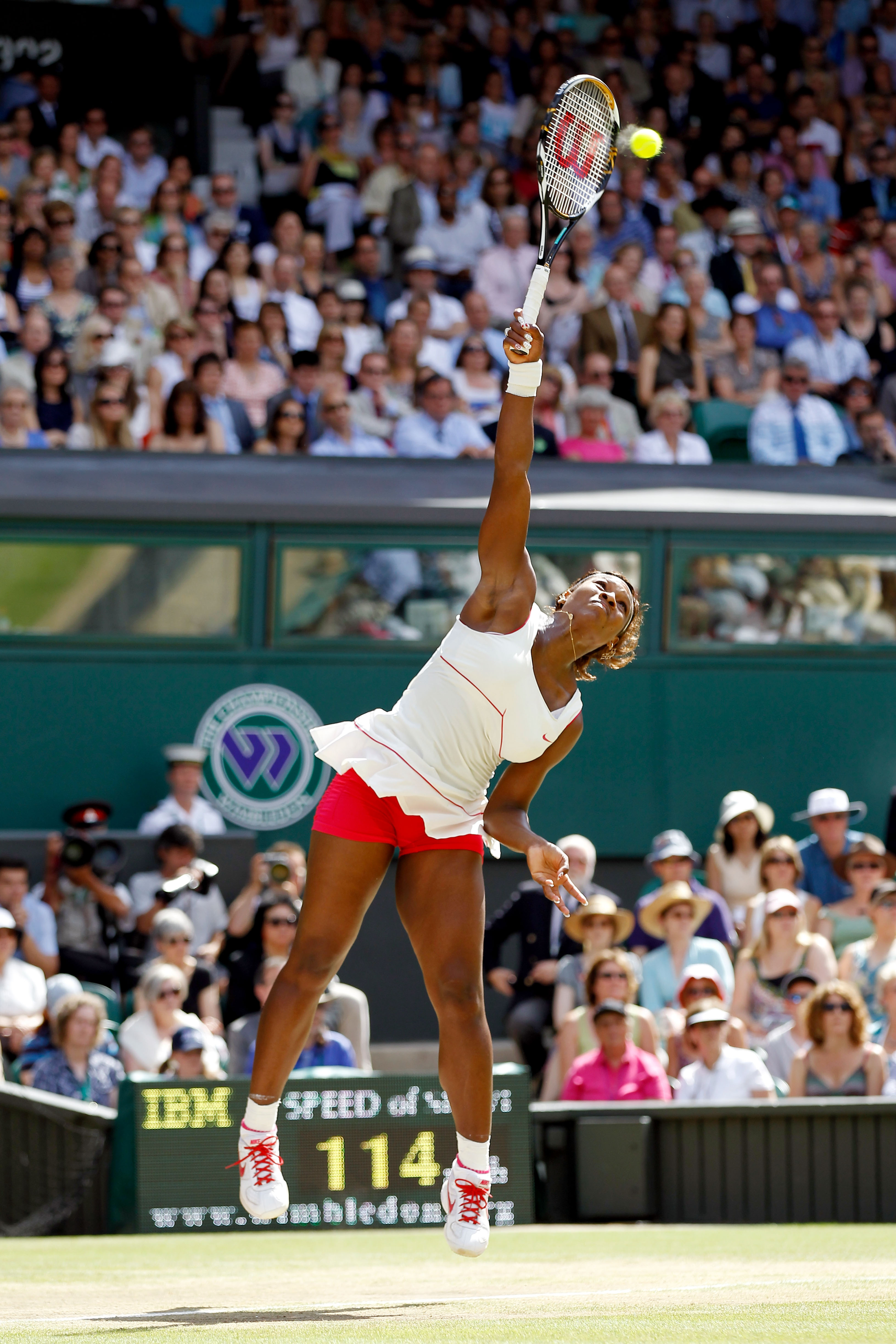 LONDON, ENGLAND - JULY 03:  Serena Williams of USA serves during the Ladies Singles Final Match against Vera Zvonareva of Russia on Day Twelve of the Wimbledon Lawn Tennis Championships at the All England Lawn Tennis and Croquet Club on July 3, 2010 in Lo