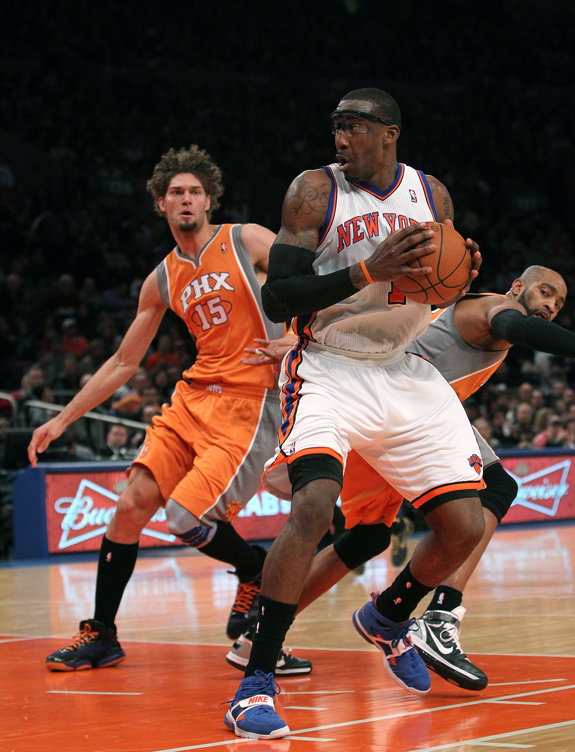 NEW YORK, NY - JANUARY 17:  Amar'e Stoudemire #1 of the New York Knicks goes to the basket against the Phoenix Suns at Madison Square Garden on January 17, 2011 in New York City. NOTE TO USER: User expressly acknowledges and agrees that, by downloading an