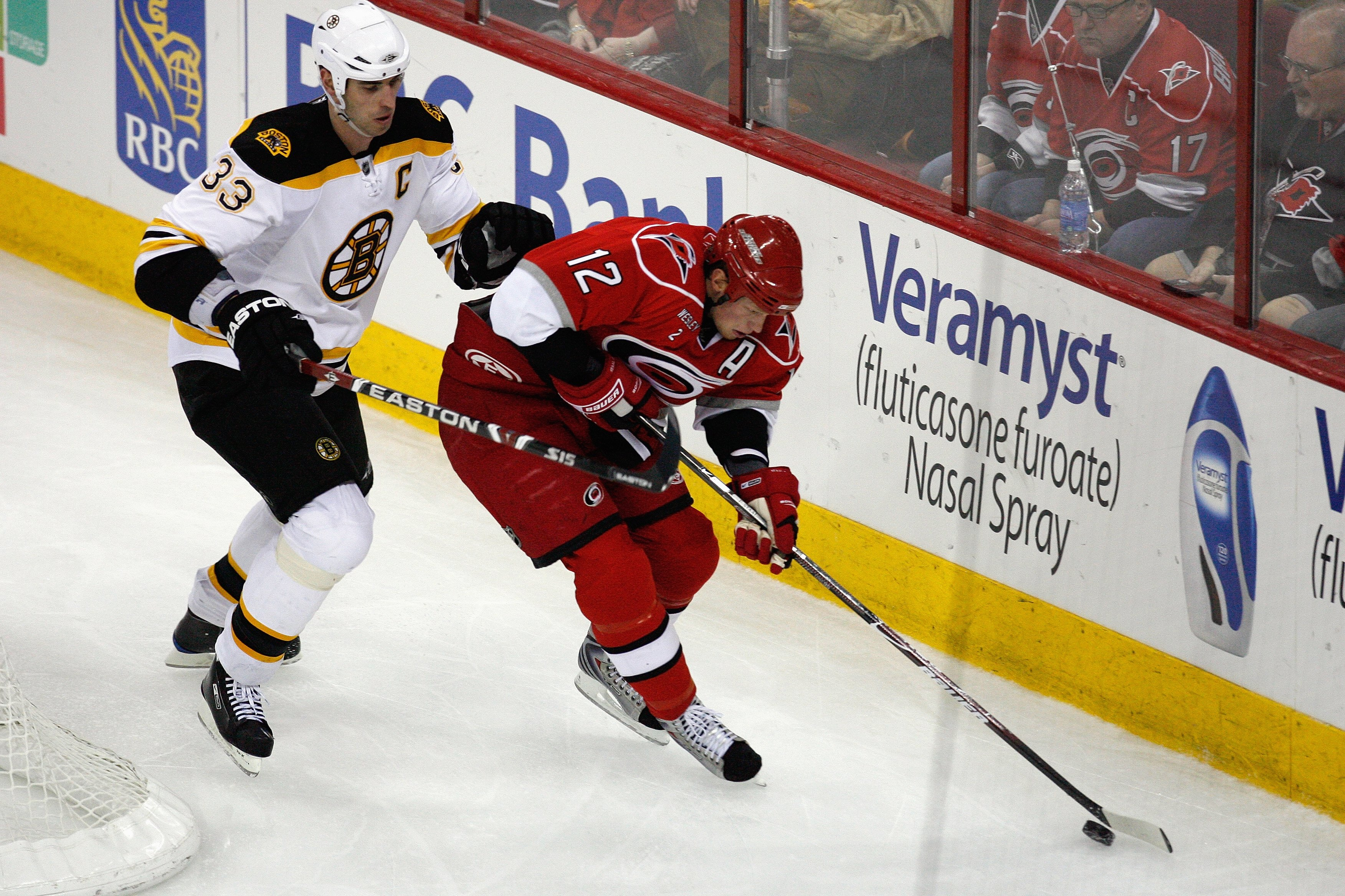 RALEIGH, NC - FEBRUARY 17:  Eric Staal #12 of the Carolina Hurricanes skates with the puck against Zdeno Chara #33 of the Boston Bruins during the game on February 17, 2009 at RBC Center in Raleigh, North Carolina.  (Photo by Kevin C. Cox/Getty Images)