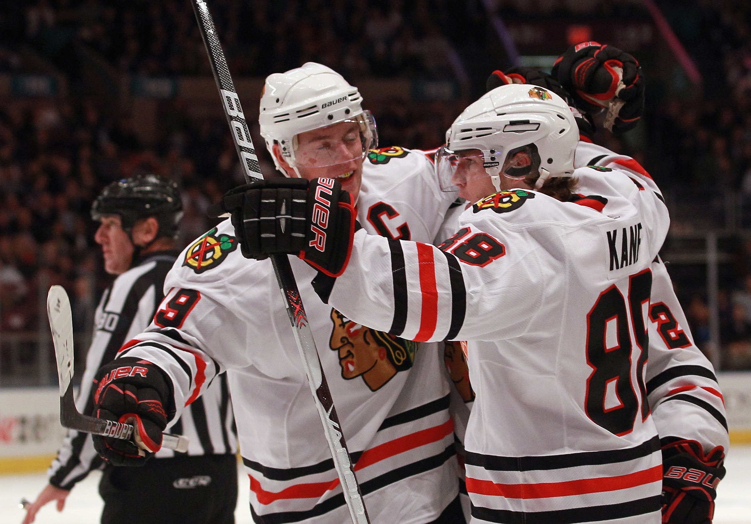 NEW YORK - NOVEMBER 01: Patrick Kane #88 (R) of the Chicago Blackhawks scores at 6:08 of the third period against the New York Rangers and is joined by Jonathan Toews #19 (L) at Madison Square Garden on November 1, 2010 in New York City. The Rangers defea