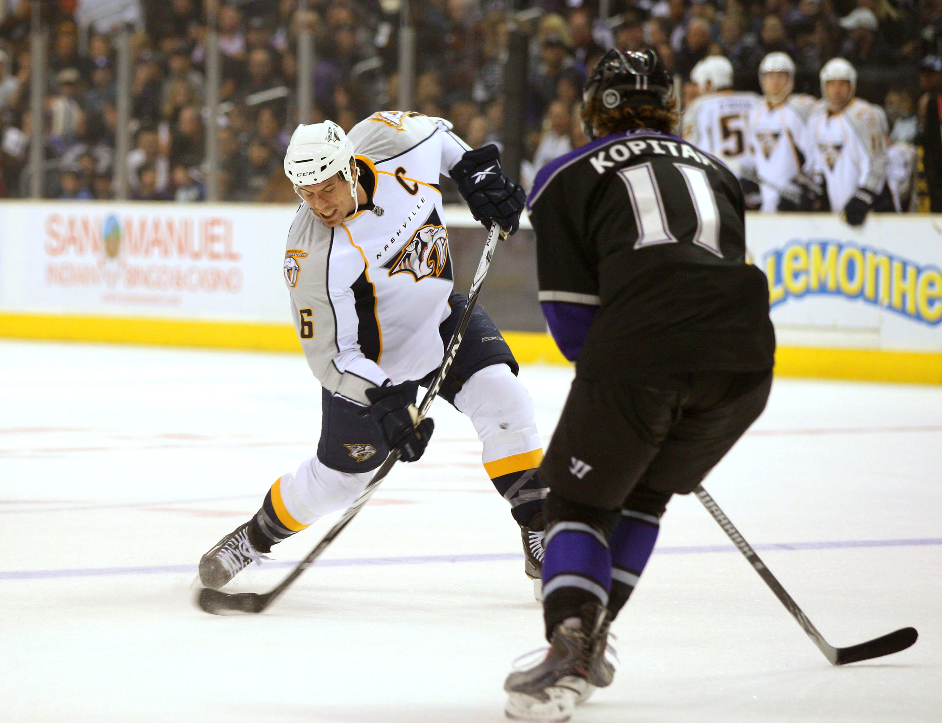 LOS ANGELES, CA - NOVEMBER 06:  Shea Weber #6 of the Nashville Predators shoots from the point under pressure from Anze Kopitar #11 of the Los Angeles Kings during the NHL game at Staples Center on November 6, 2010 in Los Angeles, California. The Kings de