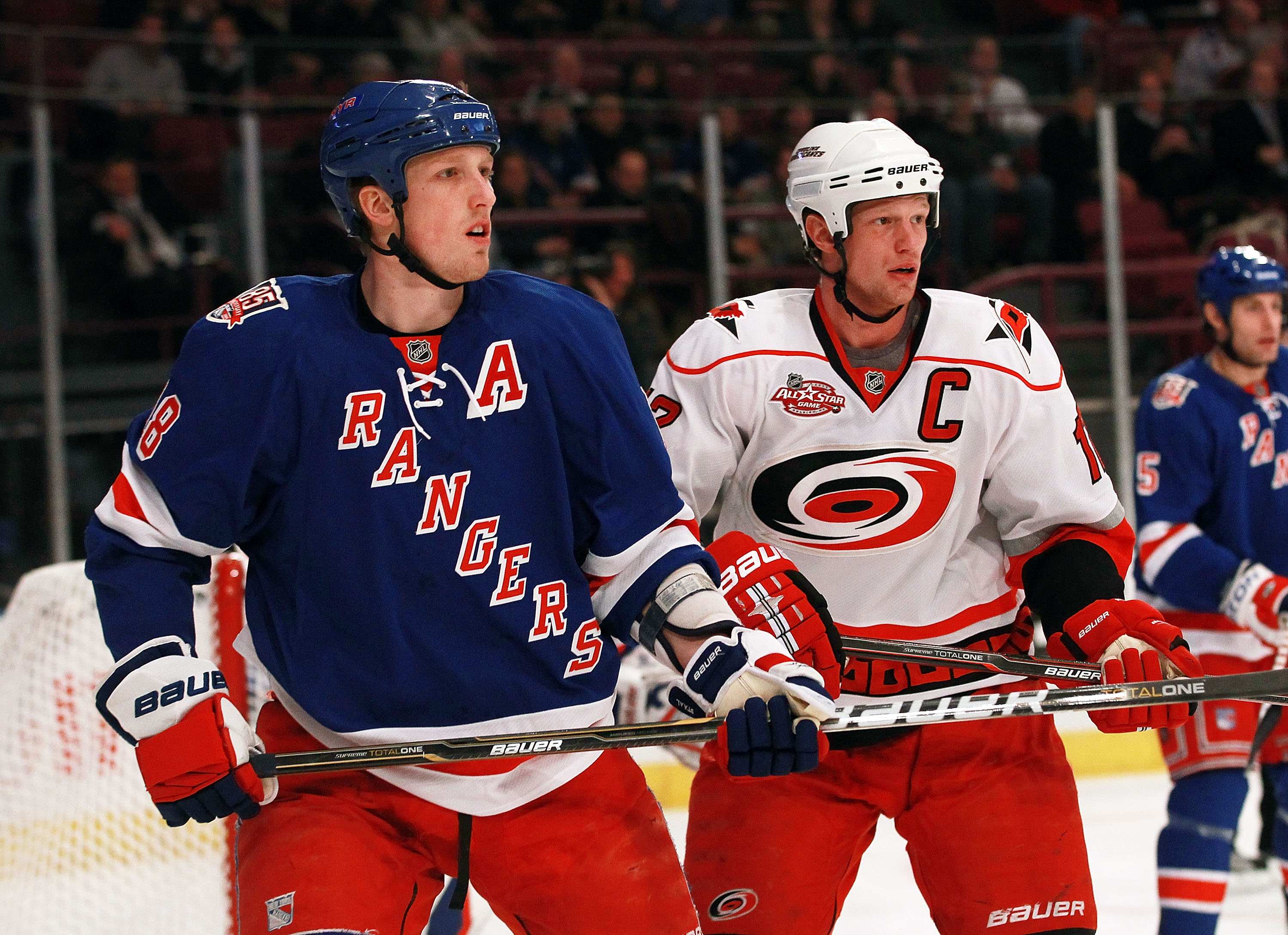 NEW YORK, NY - JANUARY 05: Marc Staal #18 of the New York Rangers skates against his brother Eric Staal #12 of the Carolina Hurricanes at Madison Square Garden on January 5, 2011 in New York City.  (Photo by Bruce Bennett/Getty Images)