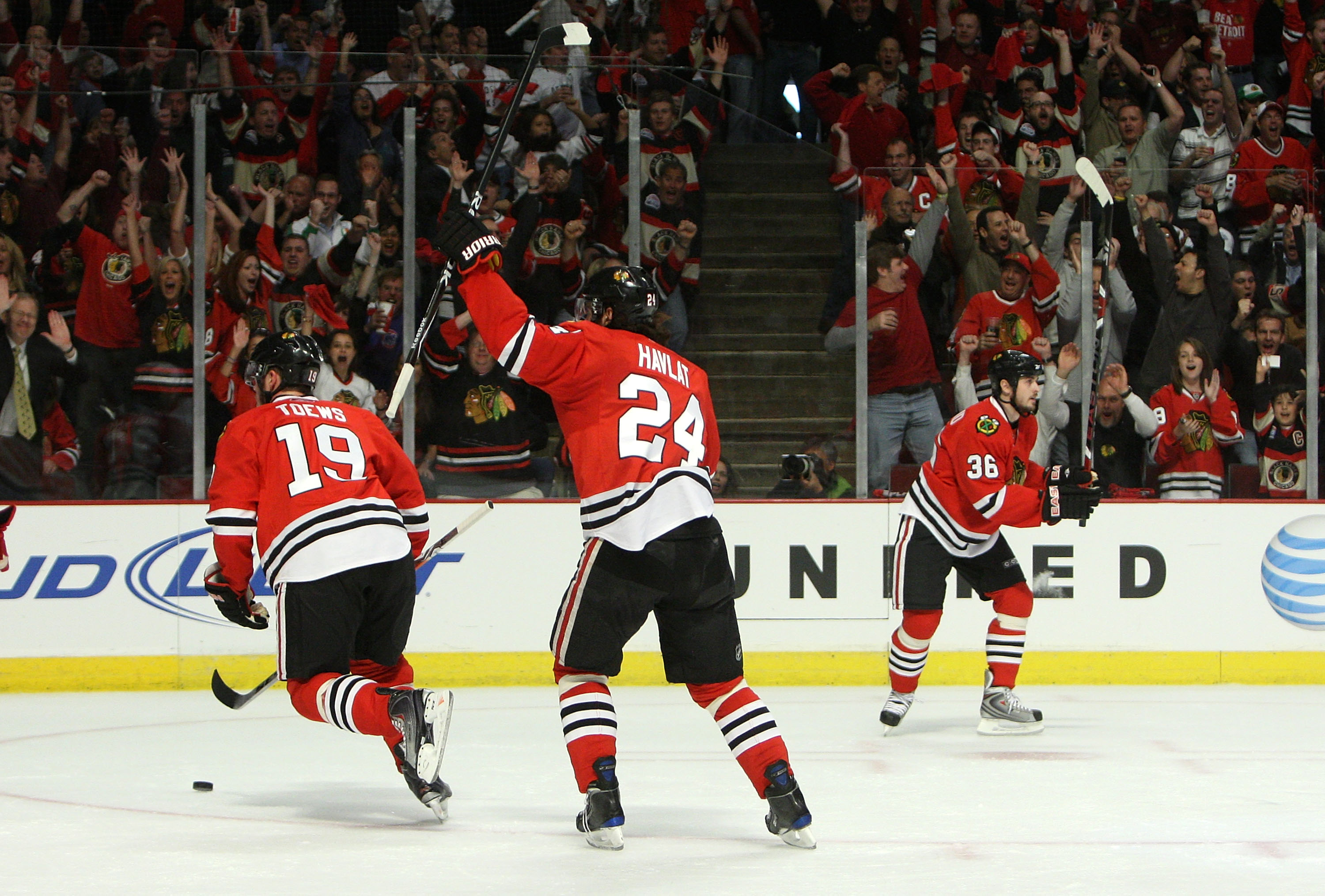 CHICAGO - MAY 22:  (L-R) Jonathan Toews #19, Martin Havlat #24 and Dave Bolland #36 of the Chicago Blackhawks celebrate after Patrick Sharp scored a power play goal in the first period against the Detroit Red Wings during Game Three of the Western Confere