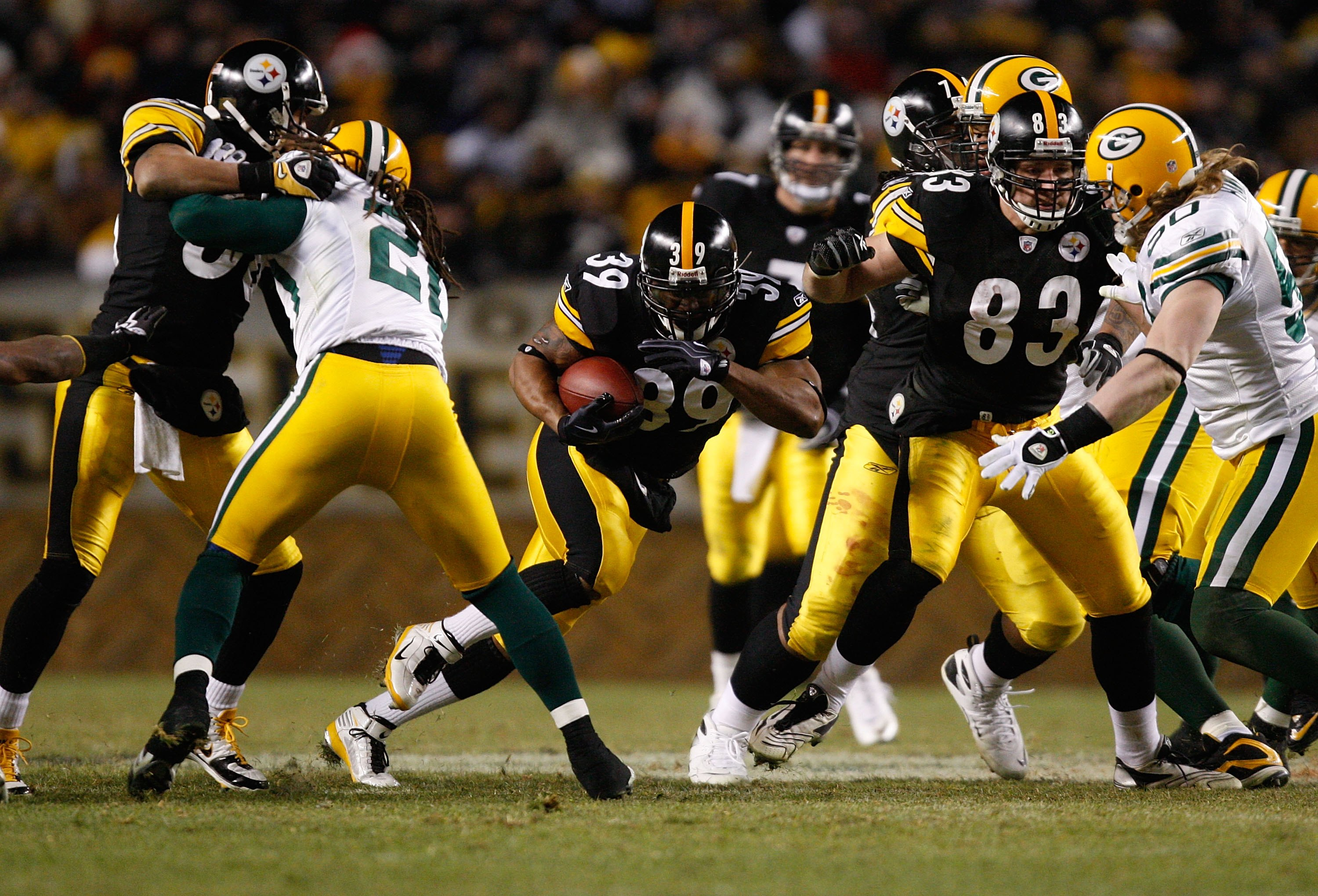 PITTSBURGH - DECEMBER 20: Willie Parker #39 of the Pittsburgh Steelers runs with the ball past Charles Woodson #21 and AJ Hawk #50 of the Green Bay Packers during the game on December 20, 2009 at Heinz Field in Pittsburgh, Pennsylvania. (Photo by Jared Wi