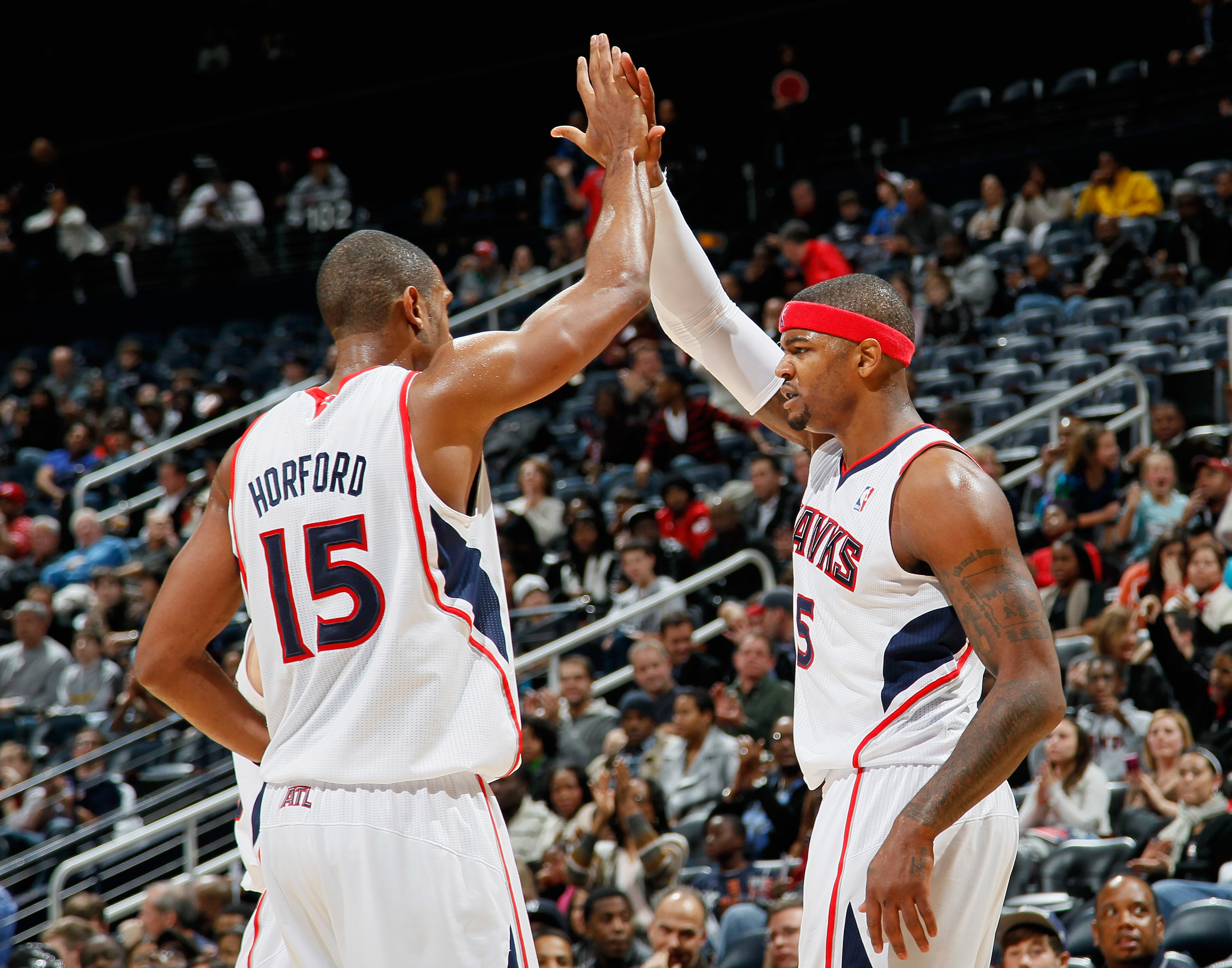 ATLANTA, GA - DECEMBER 11:  Josh Smith #5 and Al Horford #15 of the Atlanta Hawks react after Smith's basket and foul against the Indiana Pacers at Philips Arena on December 11, 2010 in Atlanta, Georgia.  NOTE TO USER: User expressly acknowledges and agre