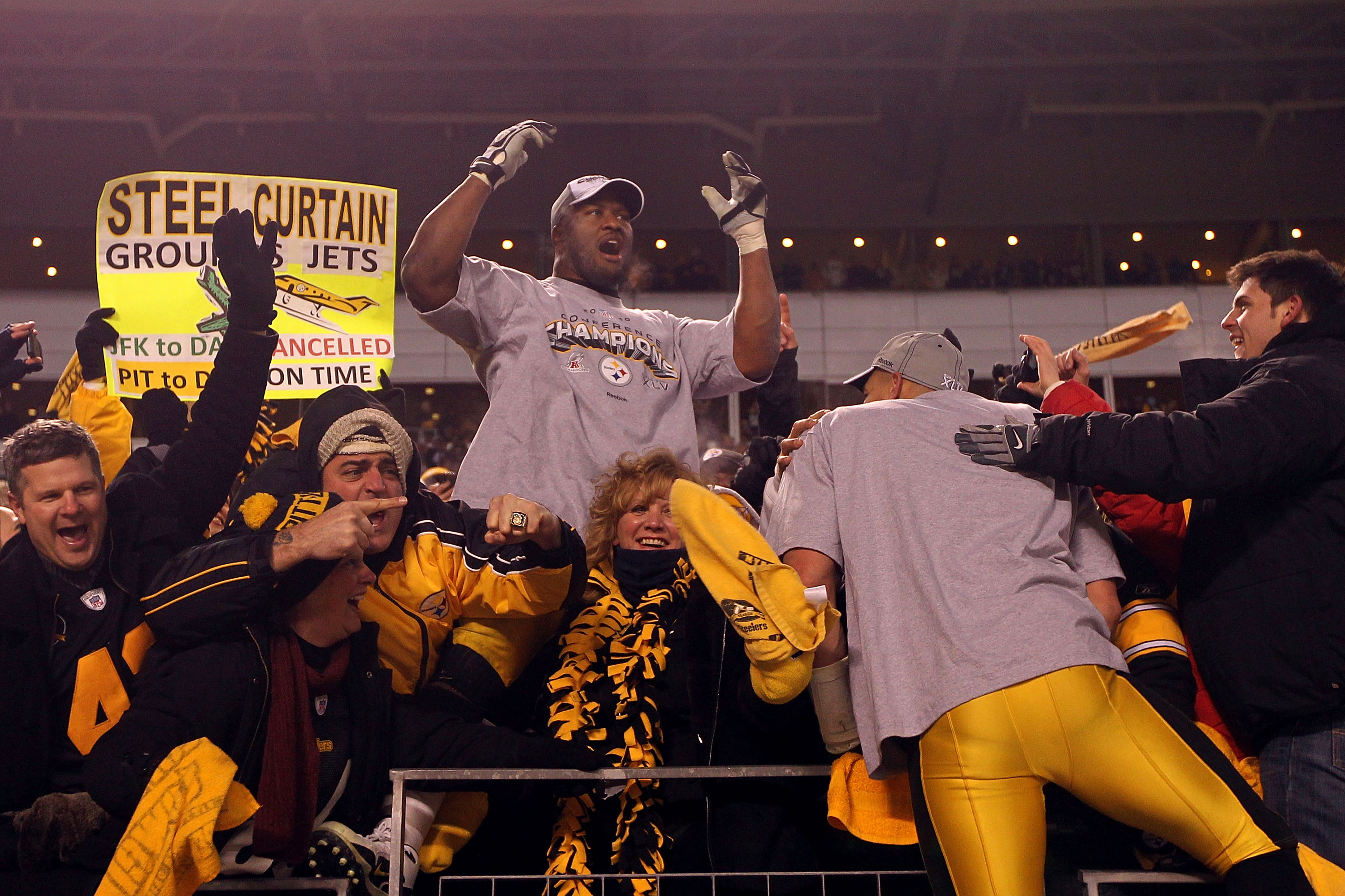 PITTSBURGH, PA - JANUARY 23:  James Harrison #92 of the Pittsburgh Steelers celebrates with fans in the stands after they defeated the New York Jets 24 to 19 in the 2011 AFC Championship game at Heinz Field on January 23, 2011 in Pittsburgh, Pennsylvania.