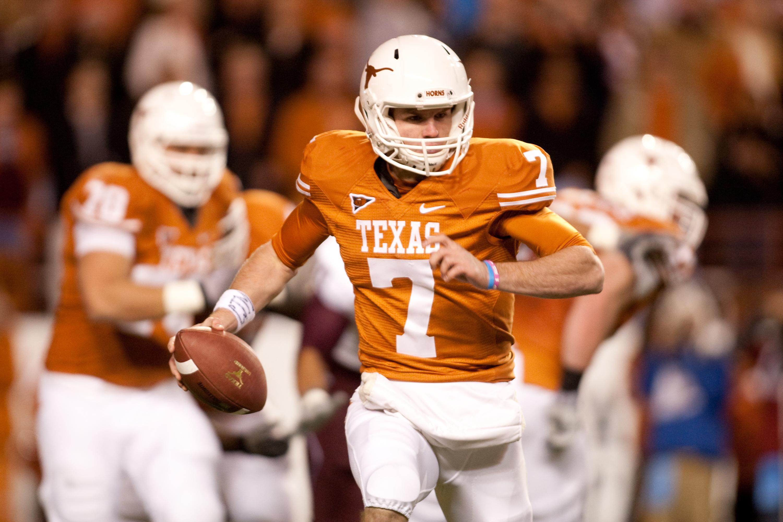 AUSTIN, TX - NOVEMBER 25:  University of Texas quarterback Garrett Gilbert #8 rushes during the first half against Texas A&M at Darrell K. Royal-Texas Memorial Stadium on November 25, 2010 in Austin, Texas. (Photo by Darren Carroll/Getty Images)