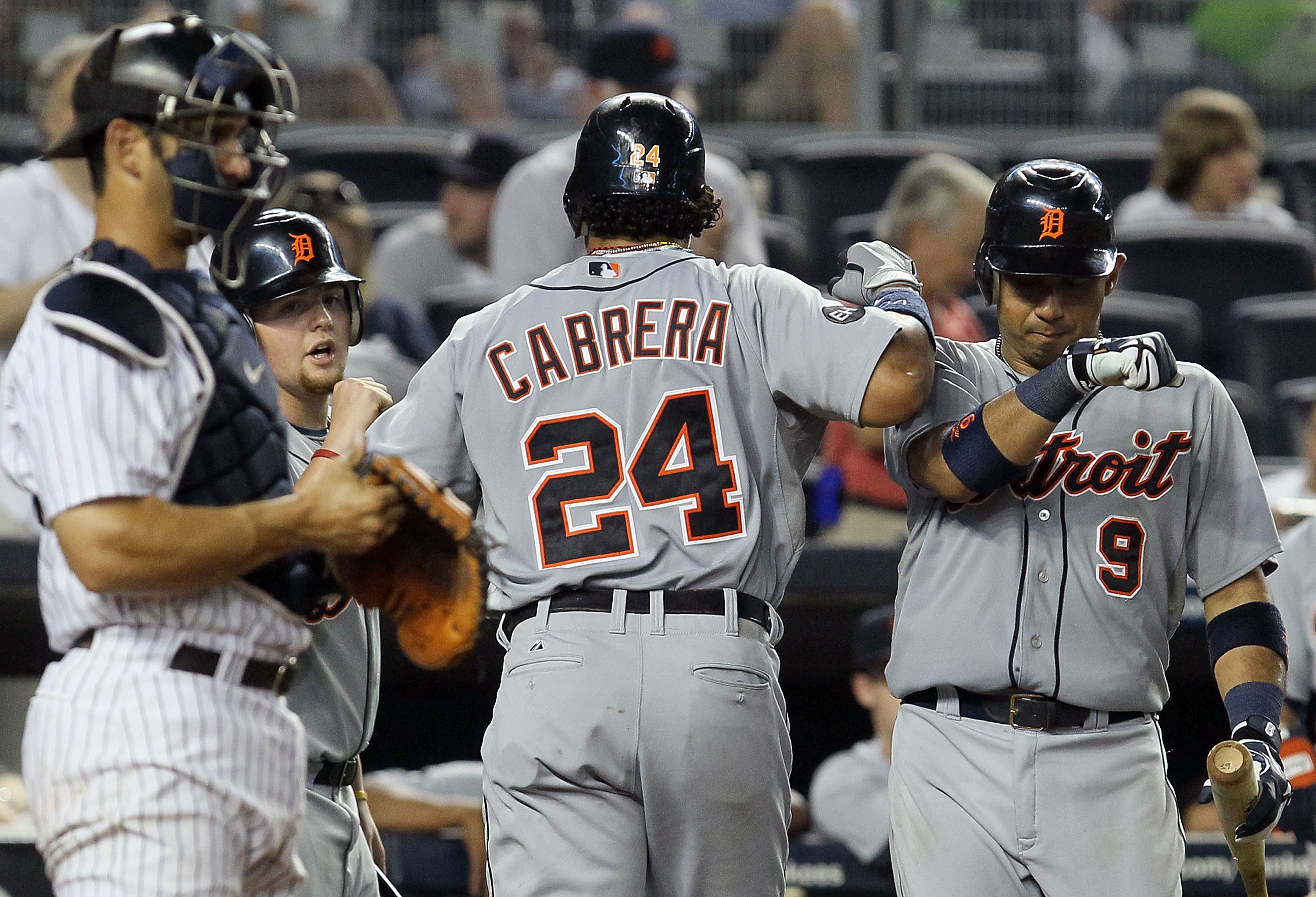 NEW YORK - AUGUST 16:  Miguel Cabrera #24 of the Detroit Tigers celebrates his ninth inning home run against the New York Yankees with teammate Carlos Guillen #9 on August 16, 2010 at Yankee Stadium in the Bronx borough of New York City. The Tigers defeat