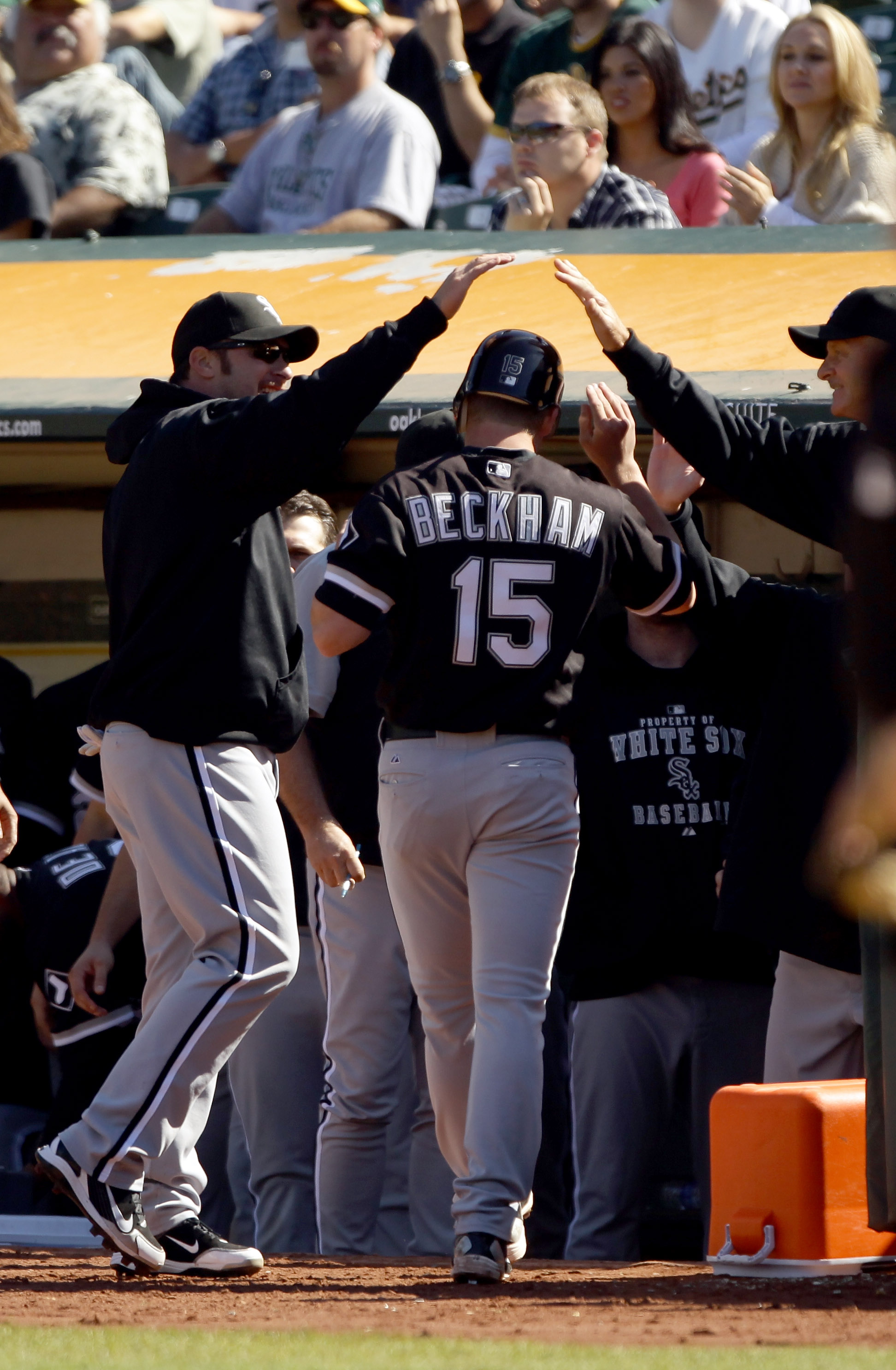 OAKLAND, CA - SEPTEMBER 22:  Gordon Beckham #15 of the Chicago White Sox is congratulated by teammates after he scored on a double by Mark Teahen #23 in the ninth inning to give the White Sox a 4-3 over the Oakland Athletics at the Oakland-Alameda County