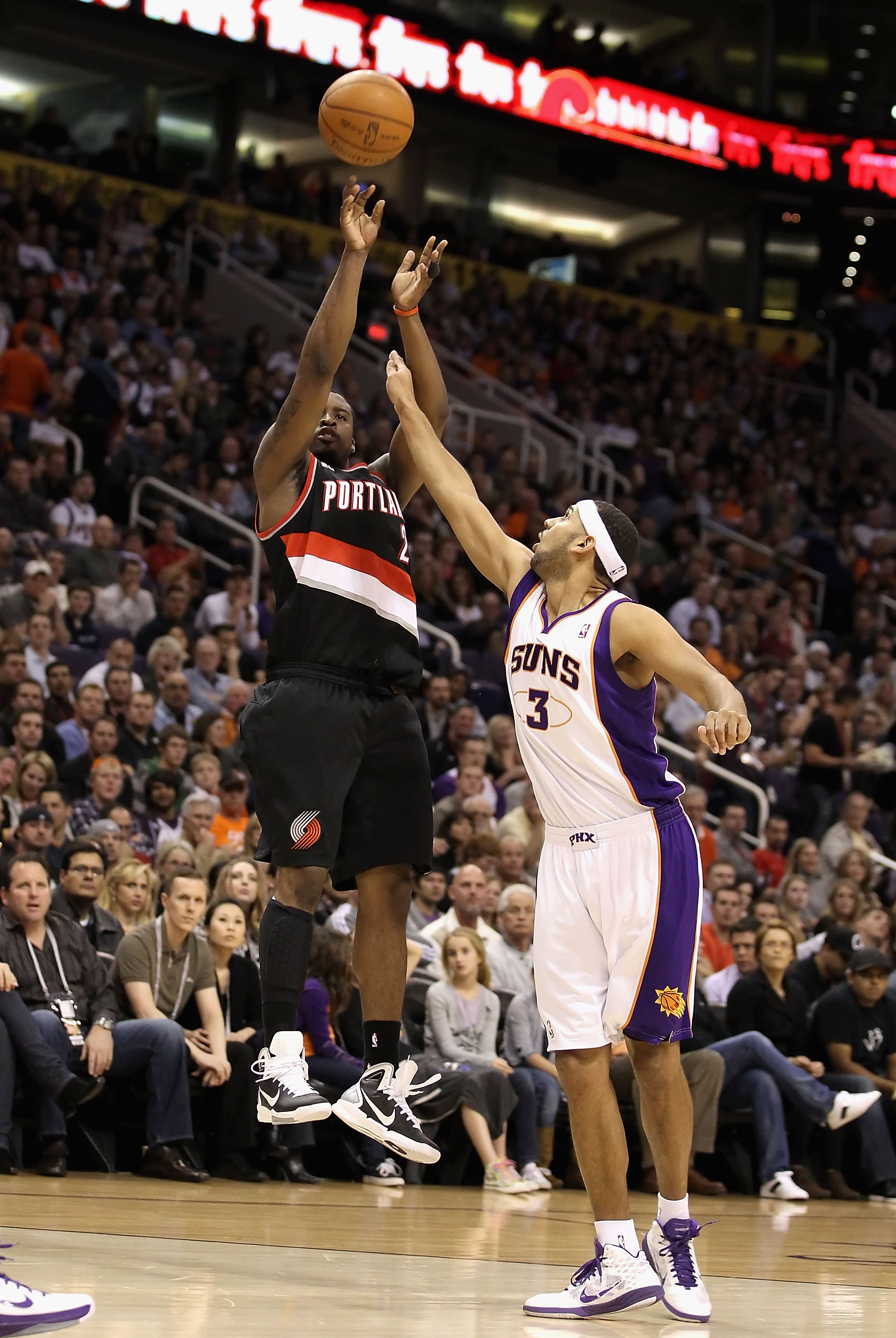 PHOENIX, AZ - JANUARY 14:  Wesley Matthews #2 of the Portland Trail Blazers puts up a shot over Jared Dudley #3 of the Phoenix Suns during the NBA game at US Airways Center on January 14, 2011 in Phoenix, Arizona.  NOTE TO USER: User expressly acknowledge