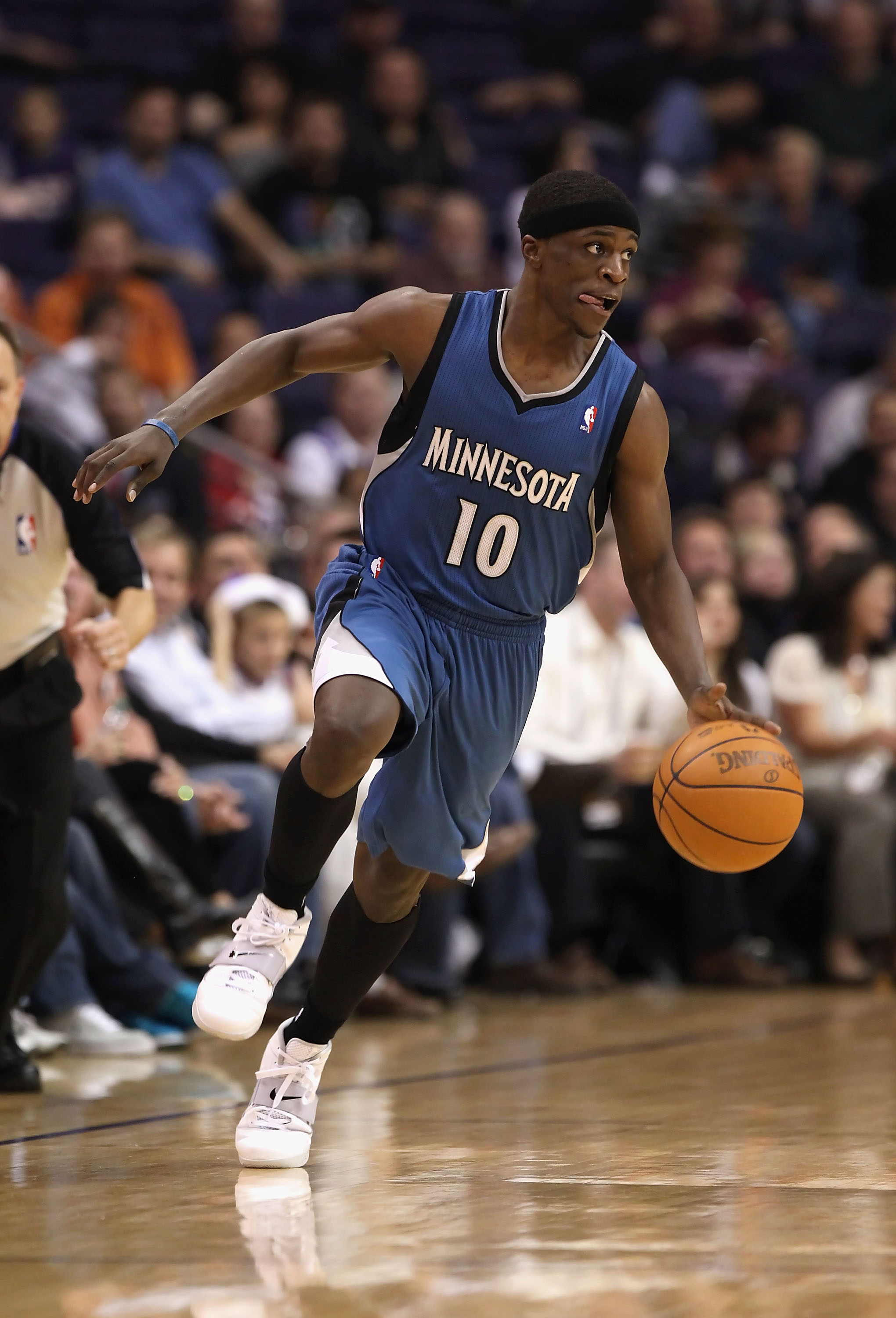 PHOENIX - DECEMBER 15:  Jonny Flynn #10 of the Minnesota Timberwolves moves the ball upcourt during the NBA game against the Phoenix Suns at US Airways Center on December 15, 2010 in Phoenix, Arizona. NOTE TO USER: User expressly acknowledges and agrees t