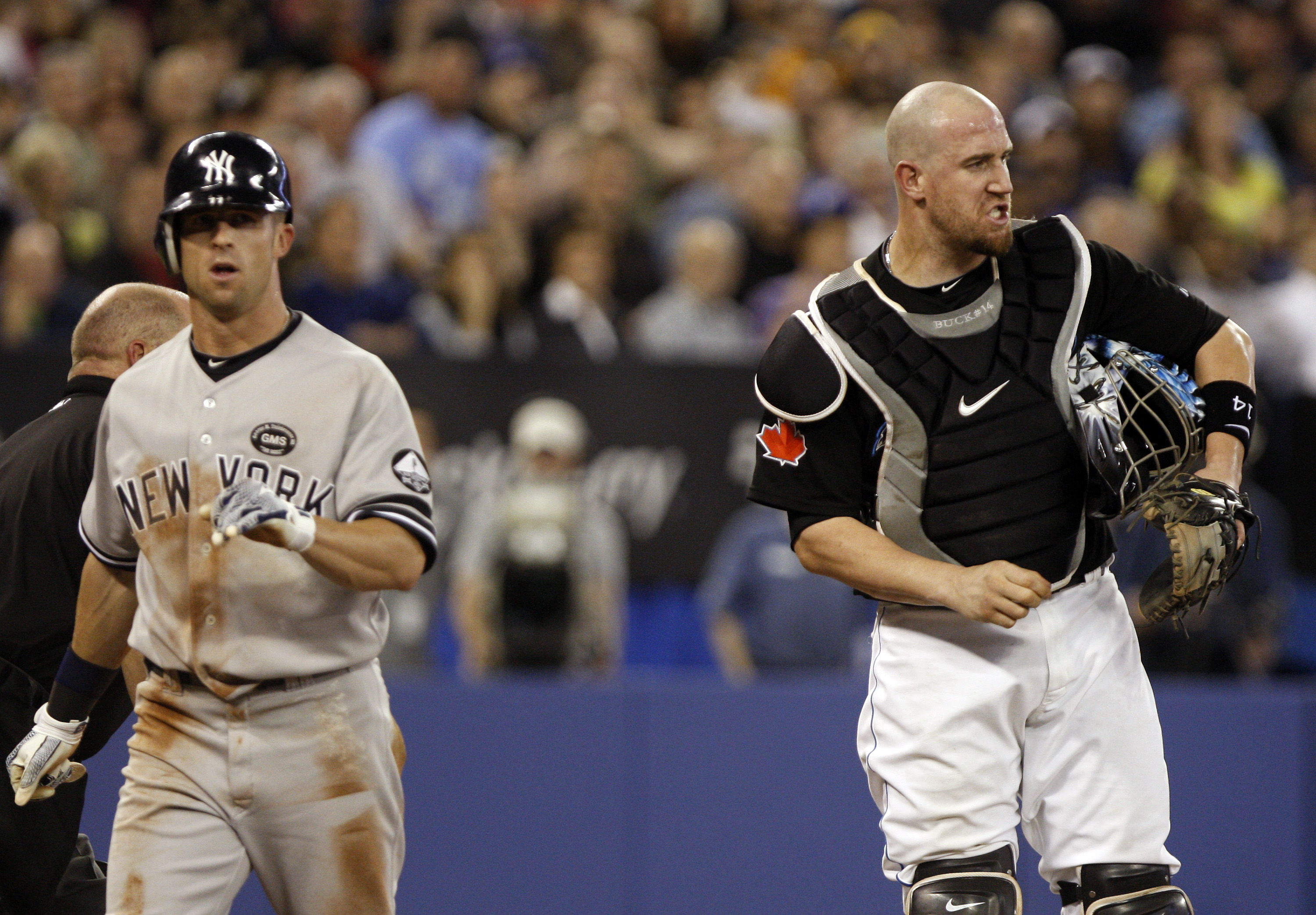 TORONTO, ON - SEPTEMBER 28: John Buck #14 of the Toronto Blue Jays reacts as Brett Gardner #11 of the New York Yankees is called safe at home during an MLB game at the Rogers Centre September 28, 2010 in Toronto, Ontario, Canada. (Photo by Abelimages/Gett
